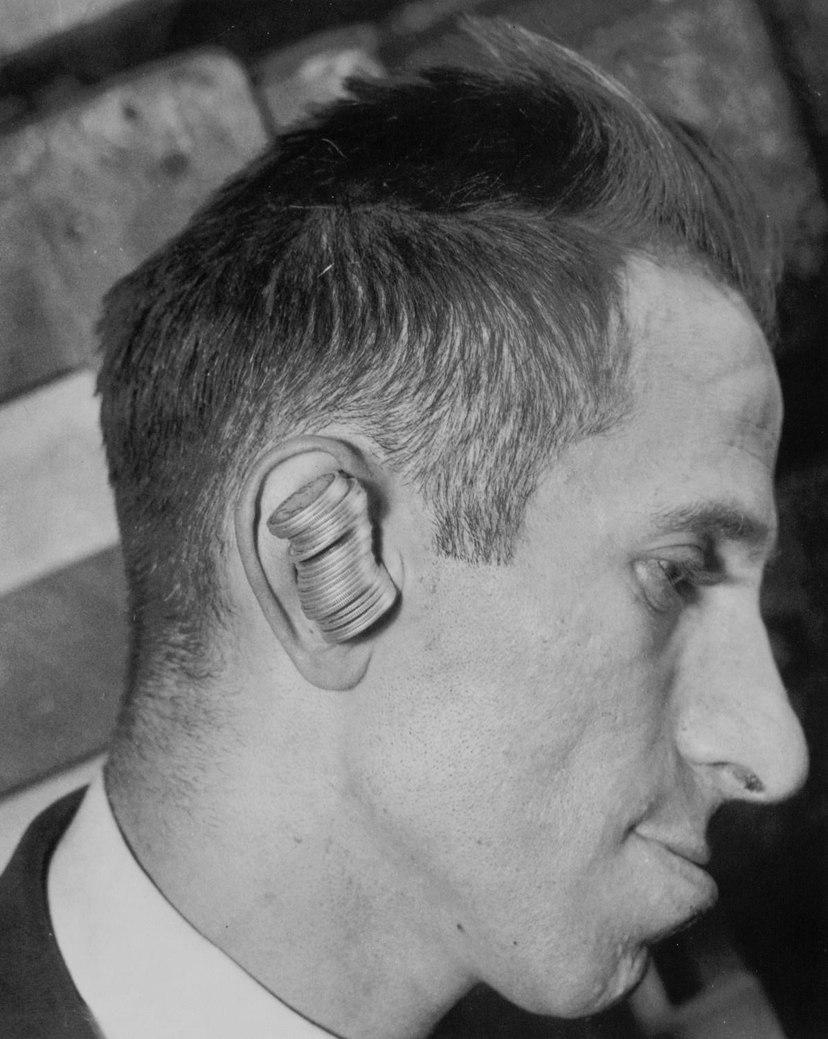 Brooklyn's Max Calvin never needed to fish for change. He could hold twenty-five quarters in his ear! (July 15, 1933)