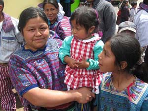 An Orthodox woman from Todos Santos stands with her two children—the future of the Church