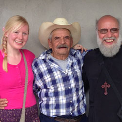 One of the 2014 short-term missionaries to Guatemala (far left) stands with a Guatemalan farmer and Fr. John Chakos. [Photo used courtesy of J. Samara]
