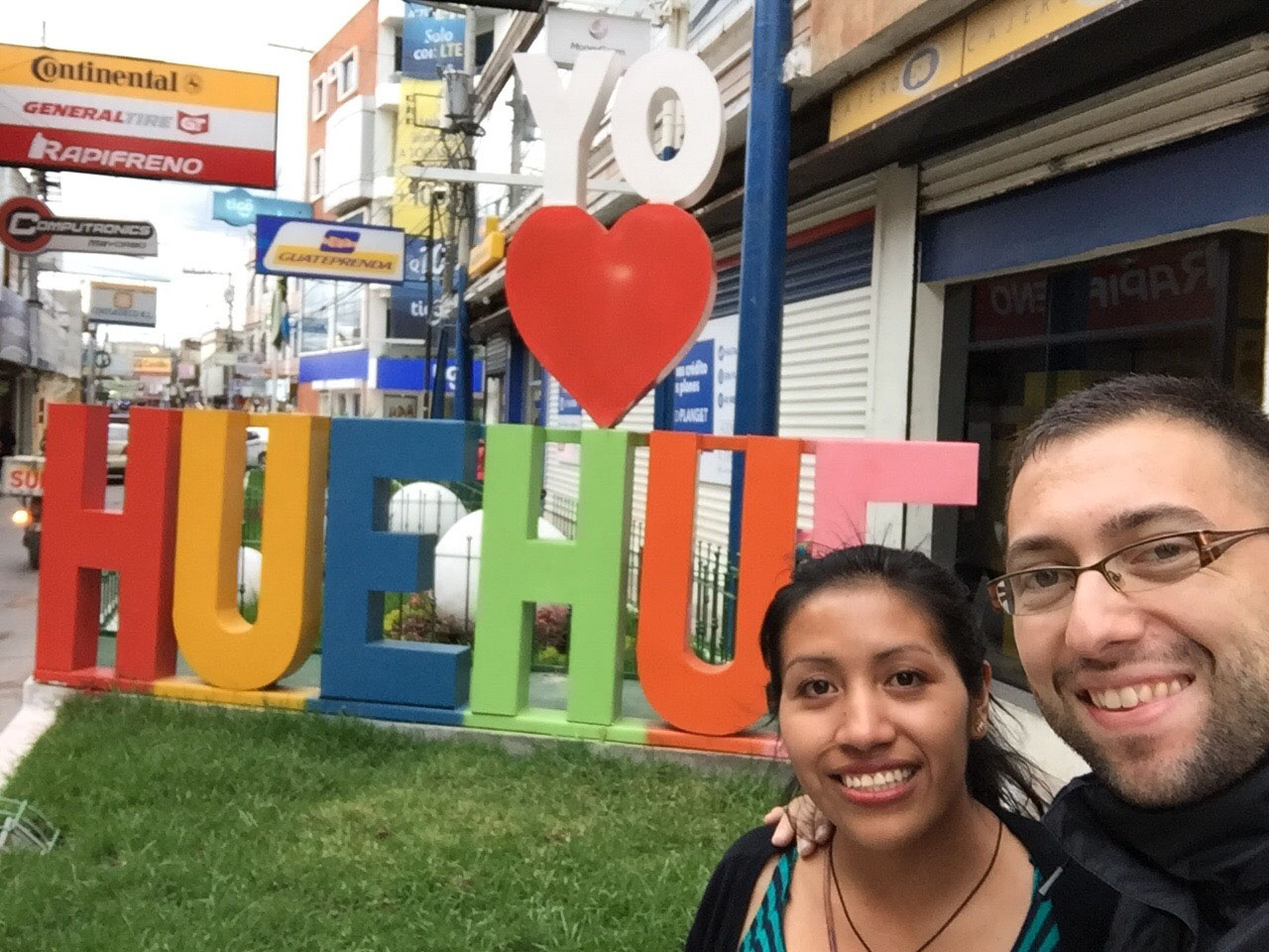 "This sign says ""I love Huehue[tenango]."" Juanita likes to say ""Huehue is our Paris"" because it's the city of our love—and the city where we will live together beginning next year."