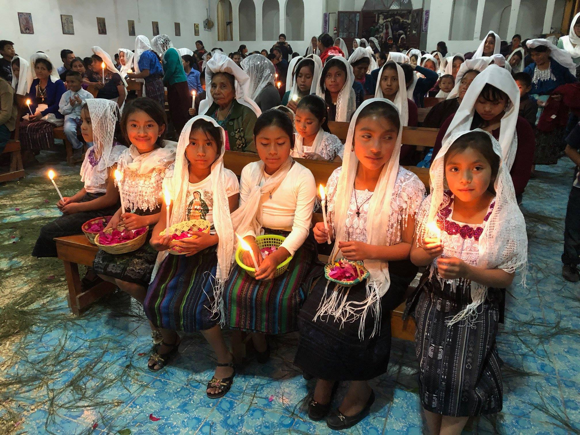 "Girls from the community as ""Miróforas"" or myrrh bearing women ready to throw their petals on Christ's Tomb"