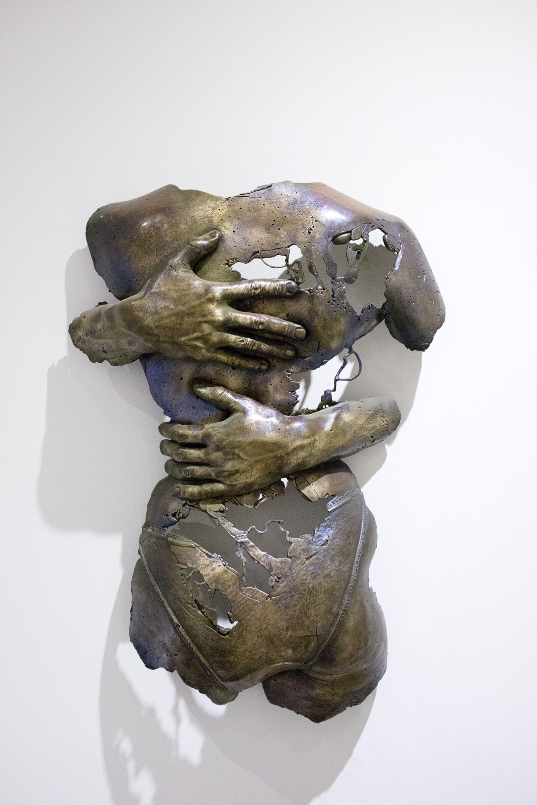 "The Hug, 1997, bronze with patina, 24"" x 7"" x 5""."