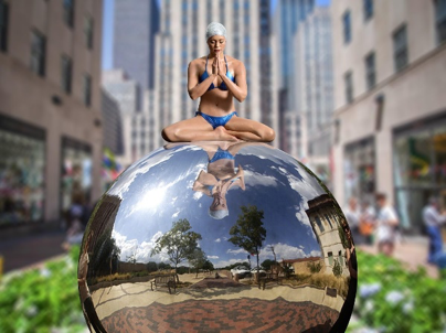 Chrysalis and the World   ,    sculpture by Carole Feuerman, patinated bronze figure and polished s  tainless steel sphere.