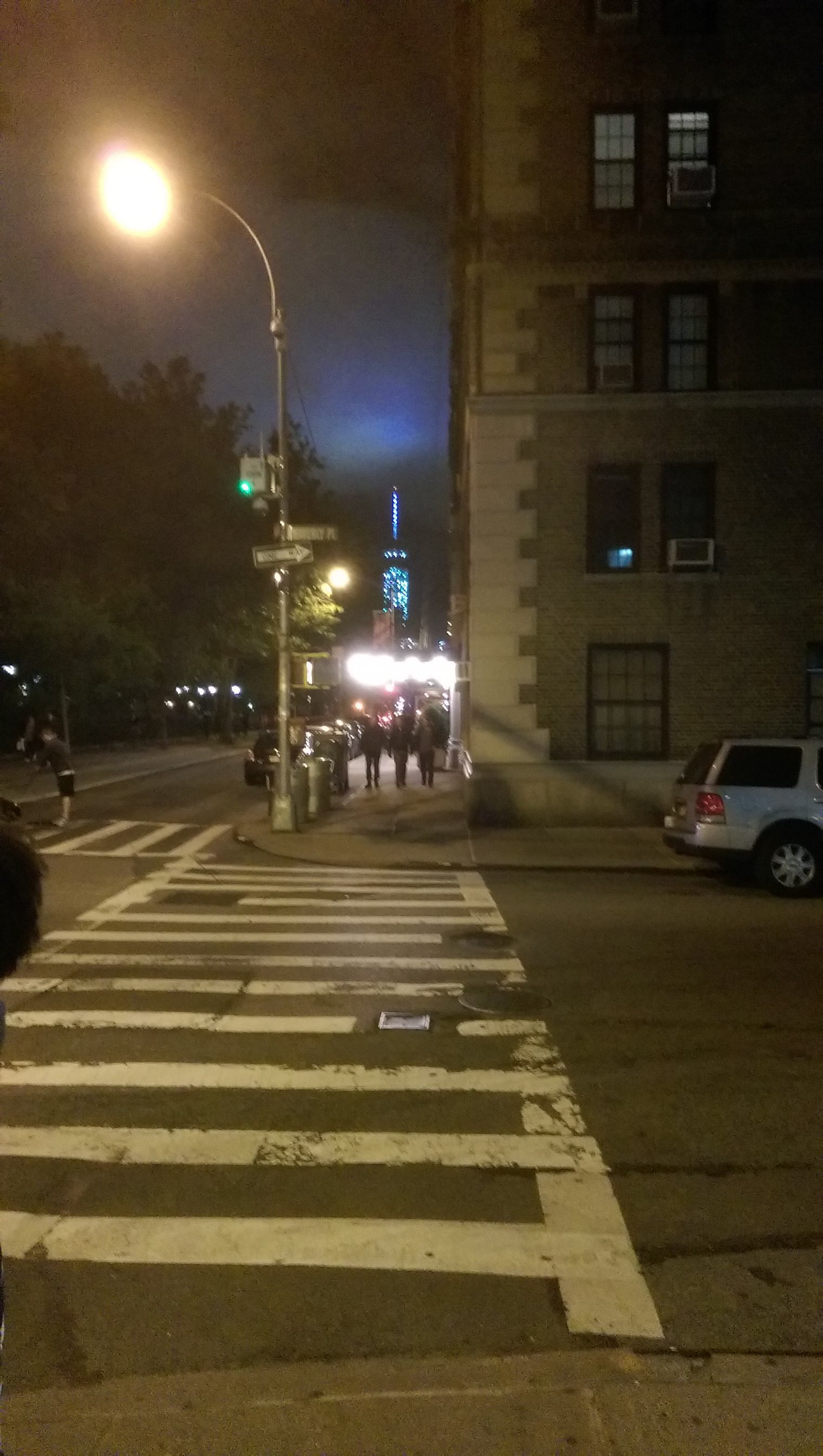 The corner of Waverly Place and Washington Square W at night... that explains all the lit buildings I bet.