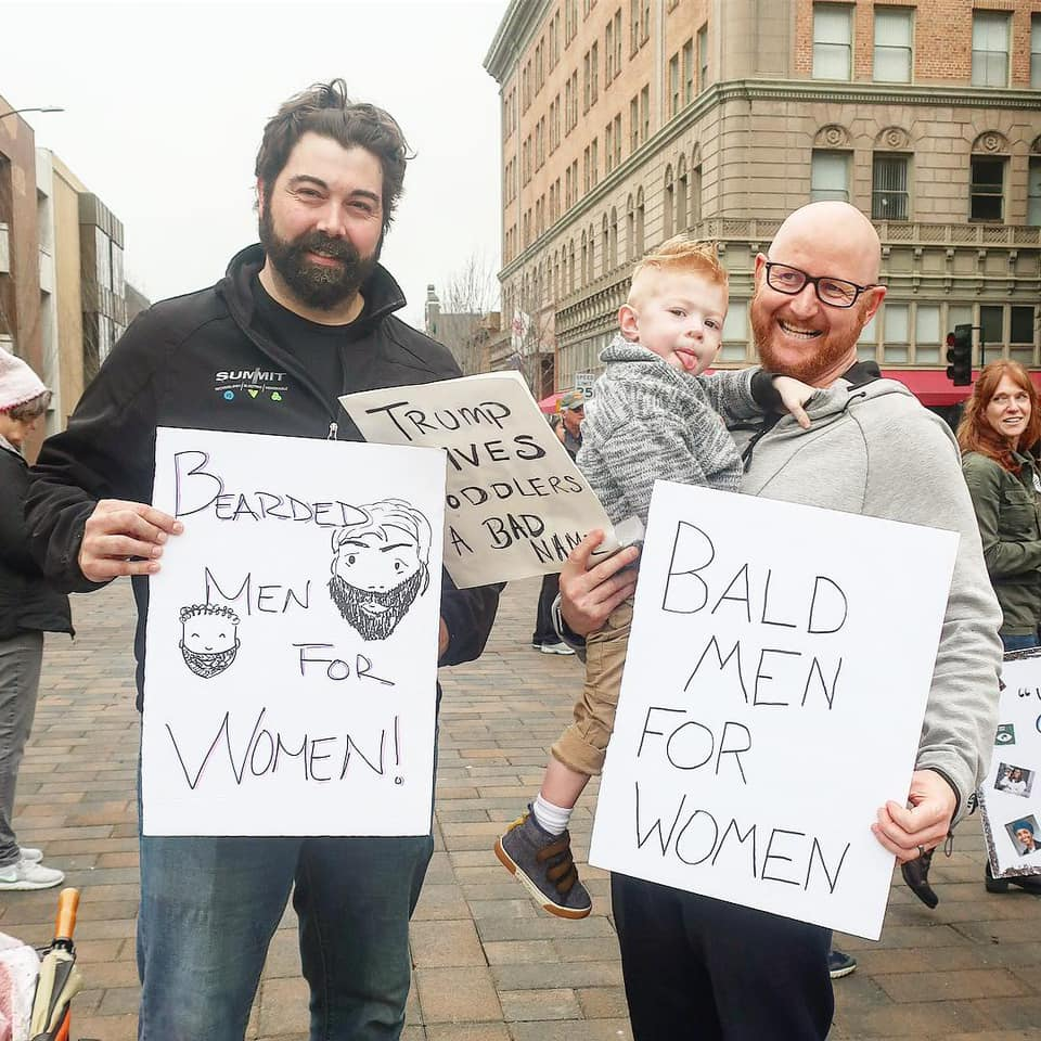 Husbands Marching during Women's March with family