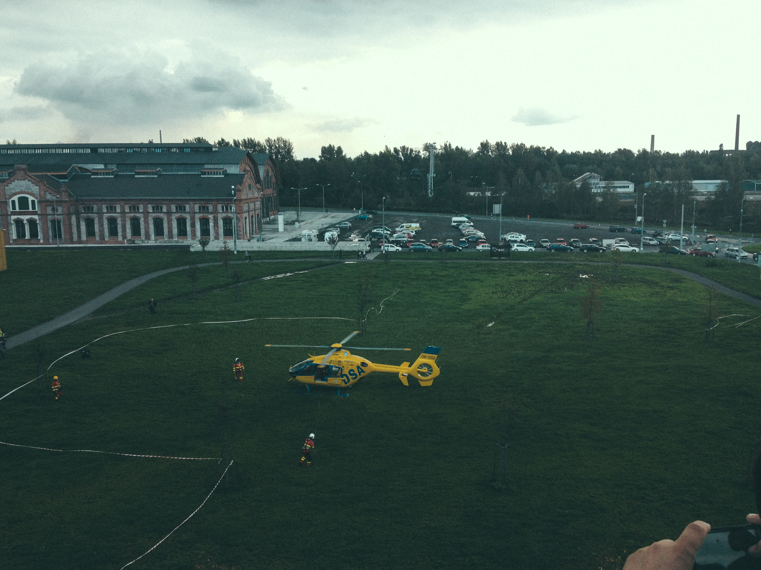 This helicopter landed in the grass right outside of the mall. I have no clue why.