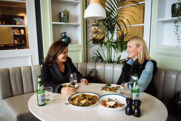 Sambag's founder Samantha Wagner and Claire Fabb of Style by Yellow Button (SbYB) photographed at The Italian Kitchen at Westfield Miranda for a content collaboration with SbYB and Westfield celebrating the centre's leading Australian fashion retailers and new eateries.