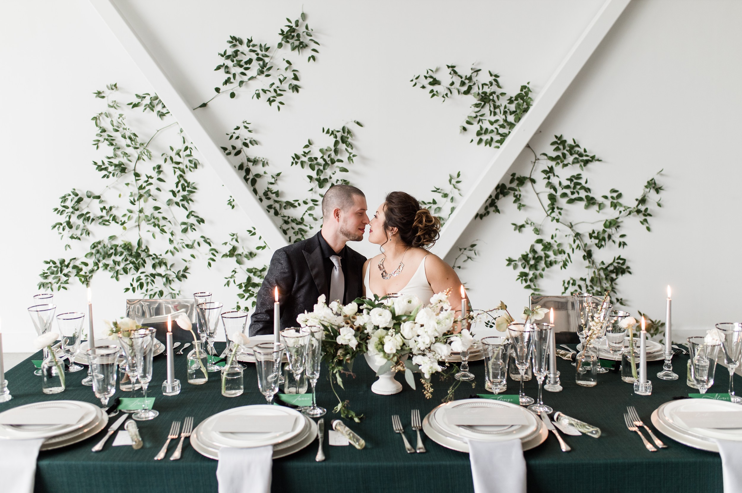 Artists for humanity epicenter wedding Boston wedding green botanical wedding inspiration ivy feature wall modern glamour candles white floral tablescape with velvet textures