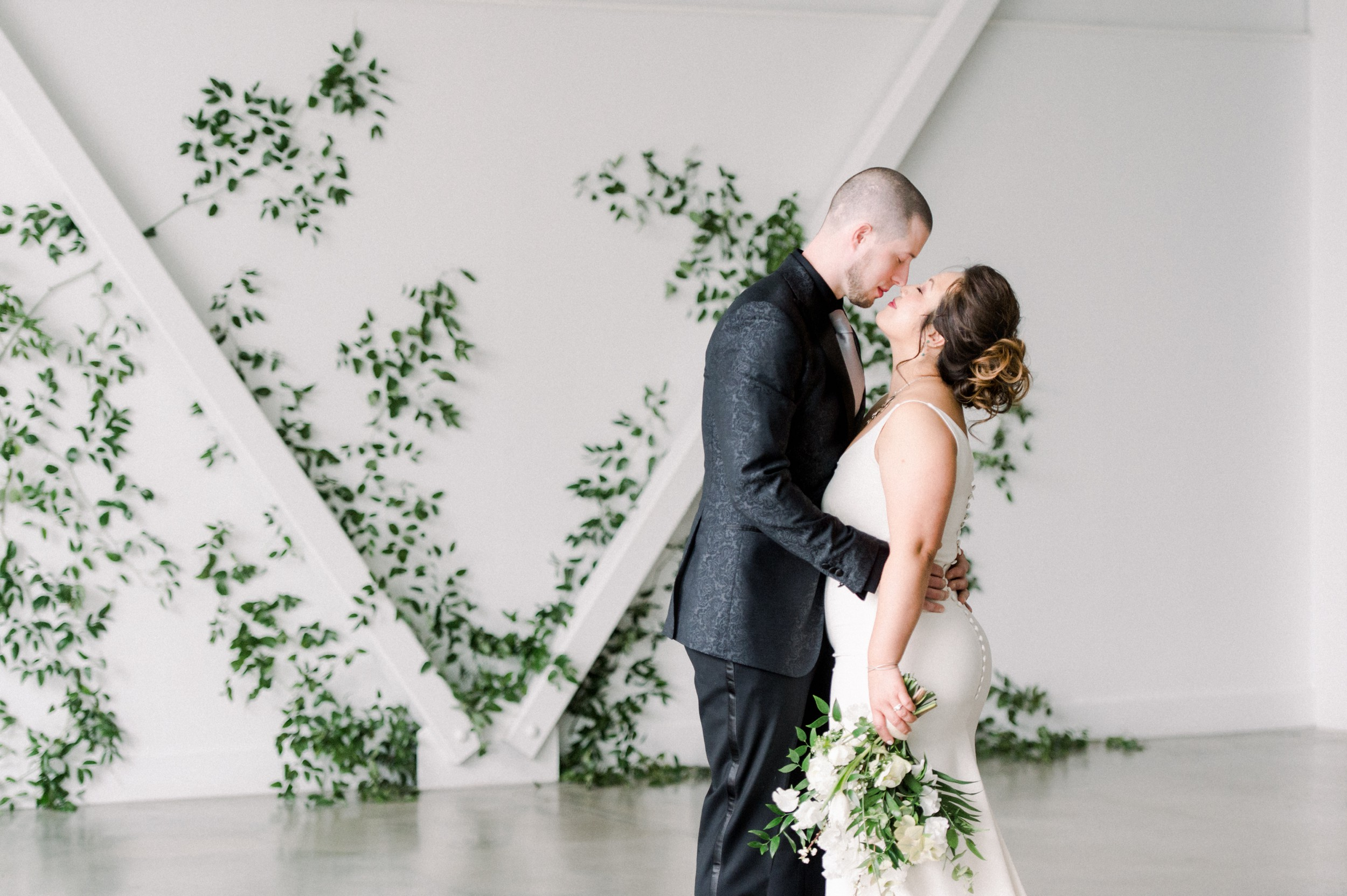 Artists for humanity epicenter wedding | Boston wedding | modern white bridal bouquet by Twig & Briar | green botanical wedding inspiration | bride and groom portraits