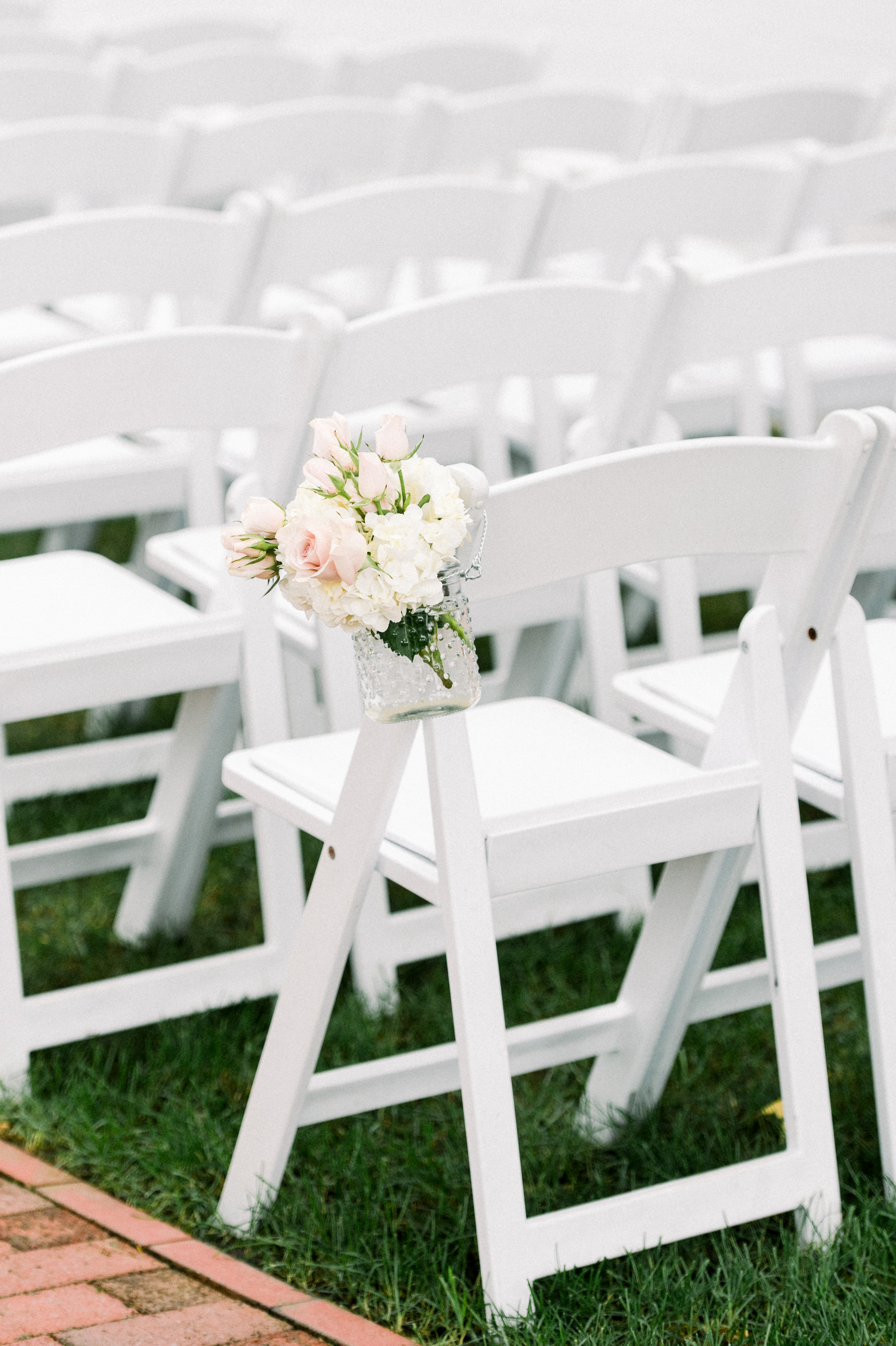 The Commons 1854 Topsfield MA wedding | Massachusetts wedding venue | Massachusetts wedding photography | outdoor wedding ceremony | white ceremony chairs | ceremony flowers | ceremony inspiration |