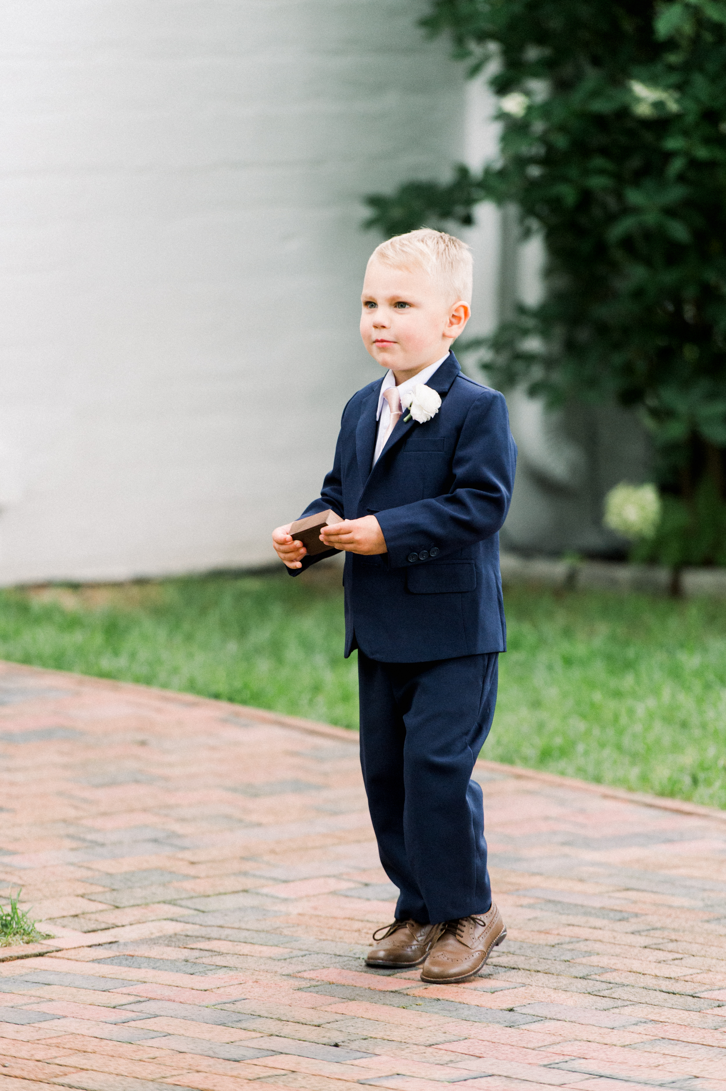 The Commons 1854 Topsfield MA wedding | Massachusetts wedding venue | Massachusetts wedding photography | ring bearer in a navy suit and pink tie | ceremony inspiration
