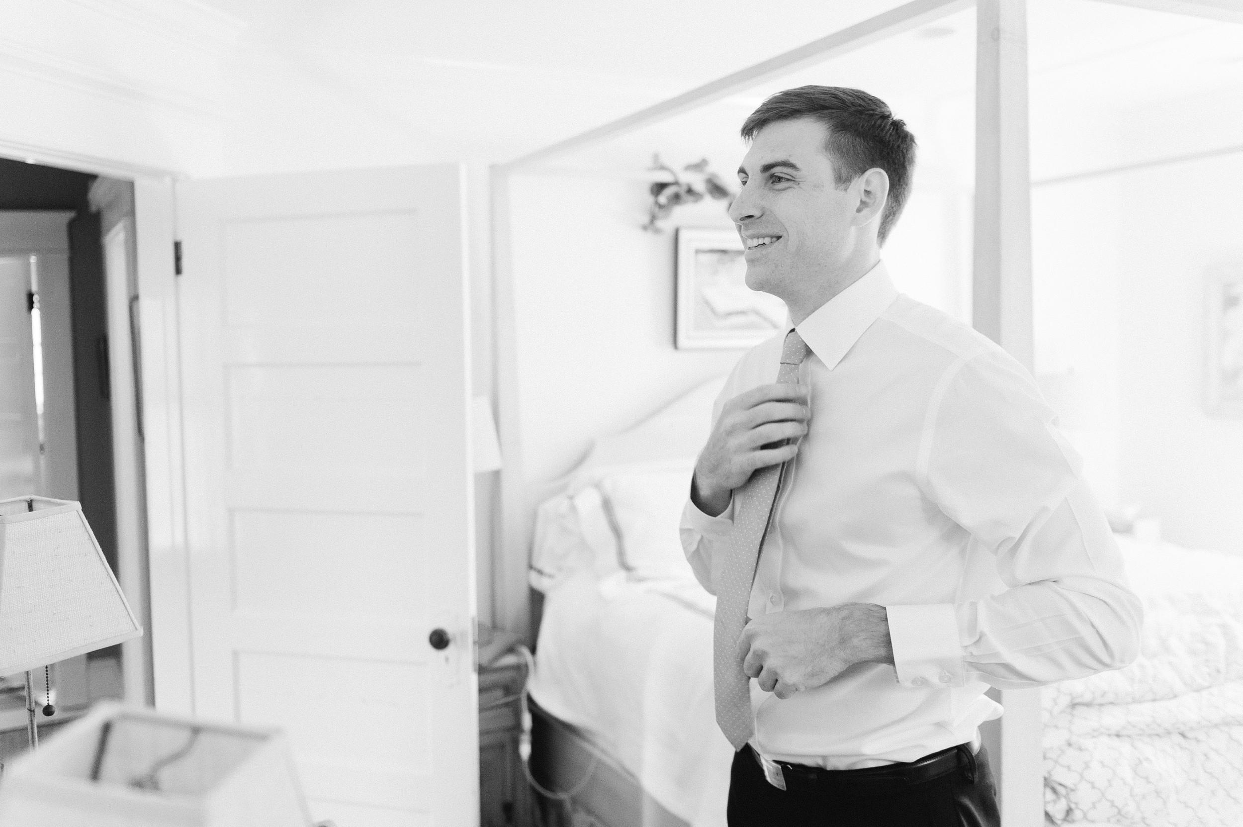 Wee Burn Beach Club Wedding Darien CT black and white groom getting ready for fall wedding on shoreline in New England