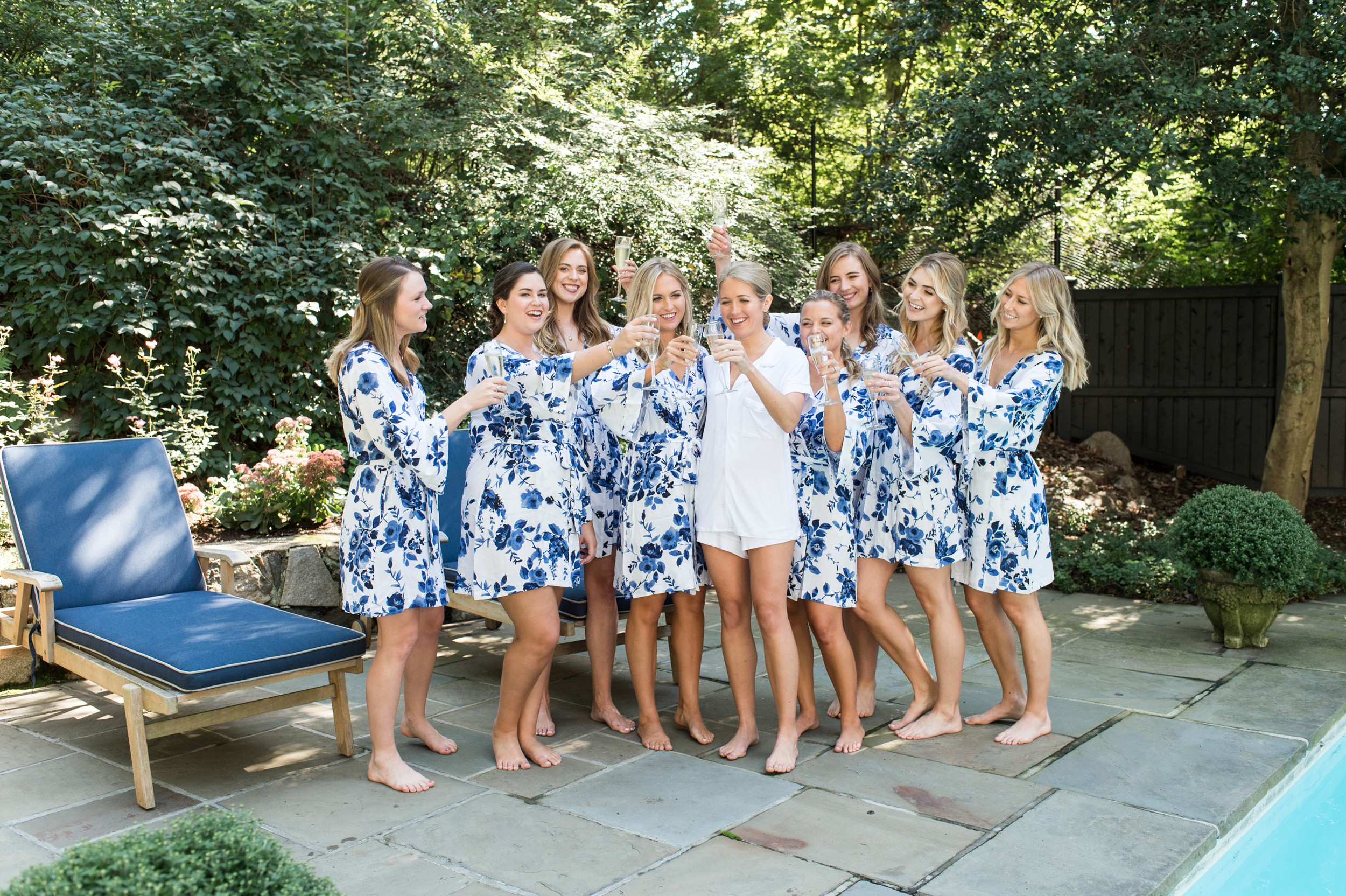 Wee Burn Beach Club Wedding Darien CT bridesmaids blue floral pajamas getting ready champagne toast
