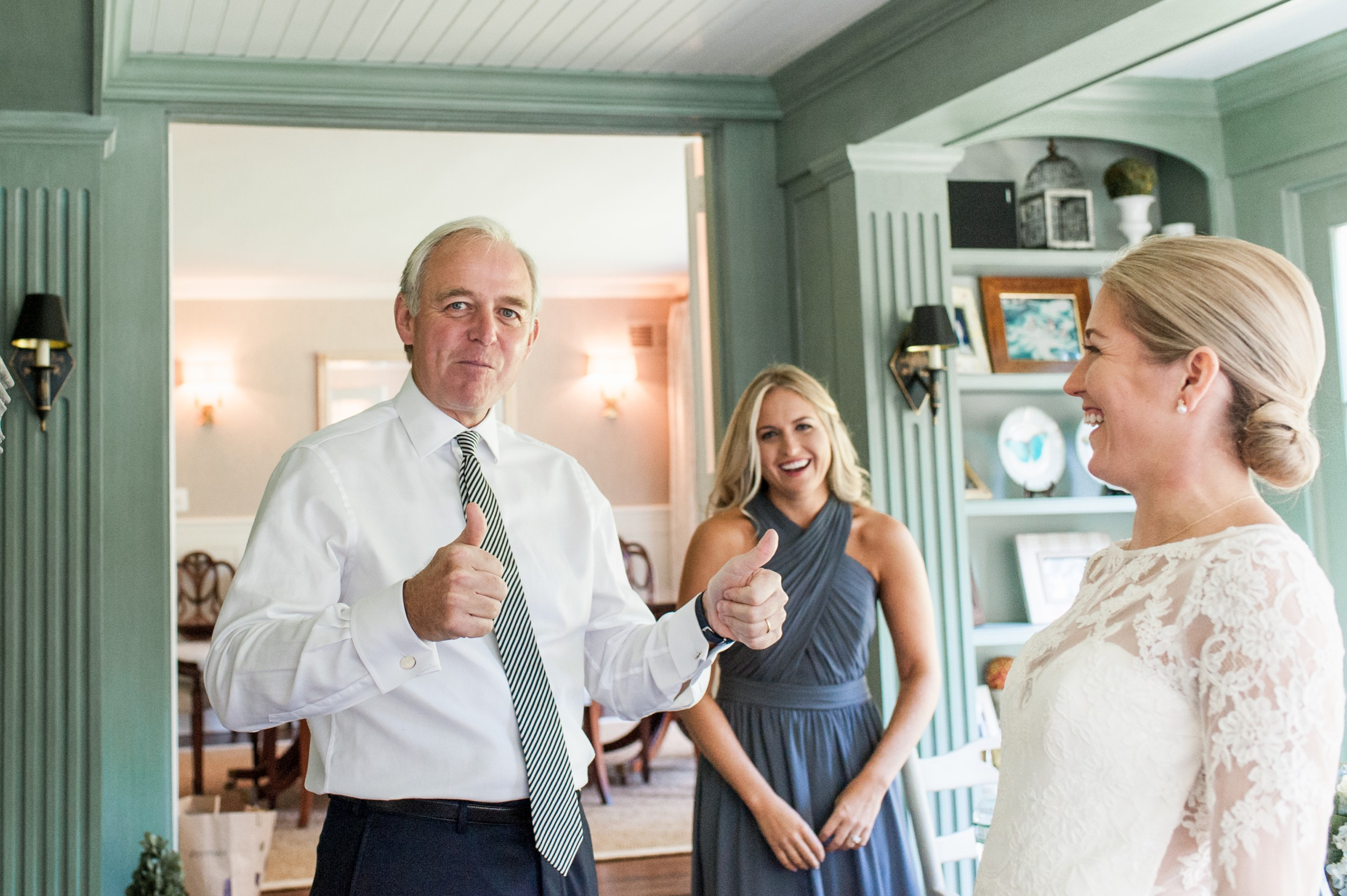 Wee Burn Beach Club Wedding Darien CT bride and dad reveal during getting ready thumbs up