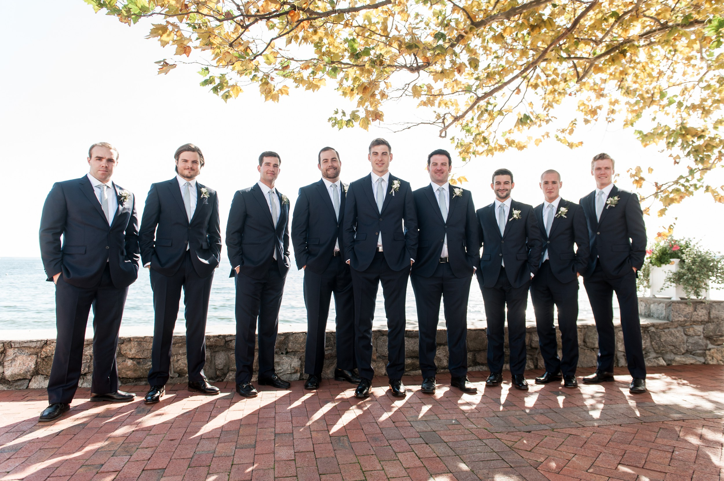 Sunny Wee Burn Beach Club Wedding Darien CT Bridal Party Portraits with Groom and Groomsmen in Navy Suits and Gray Ties