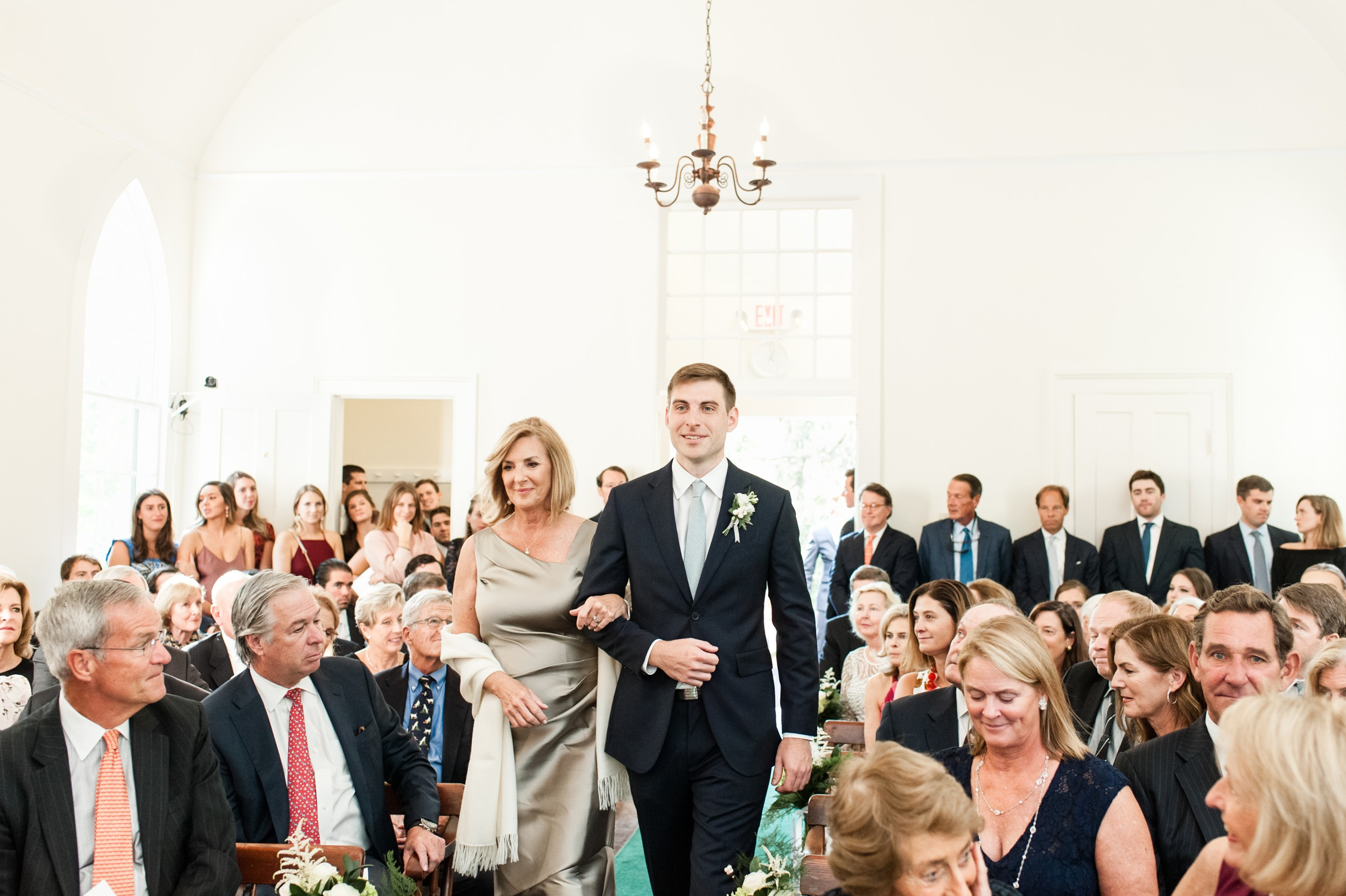 Wee Burn Beach Club Wedding Darien CT Talmidge Hill Community Church Wedding Ceremony groom walking down aisle with mom