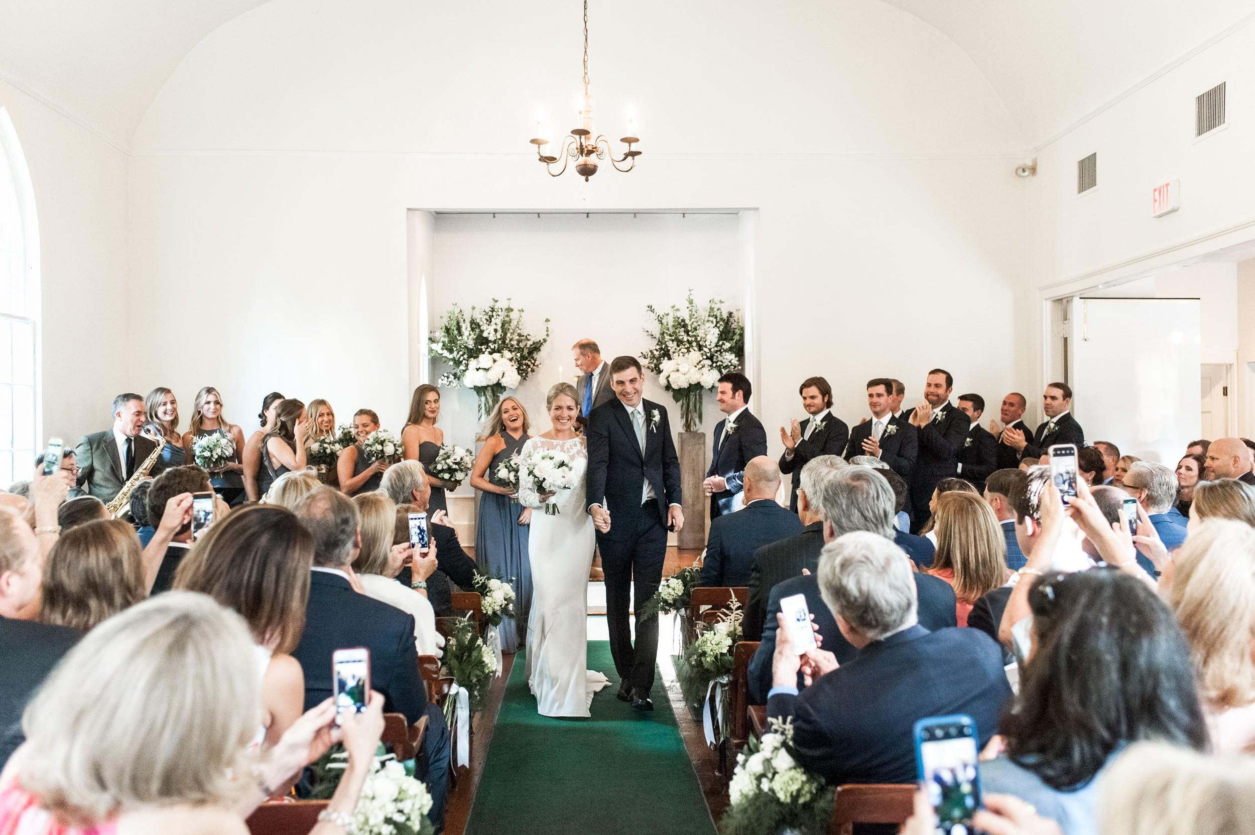 Wee Burn Beach Club Wedding Darien CT Talmidge Hill Community Church Wedding Ceremony bride and groom walk down the aisle as husband and wife