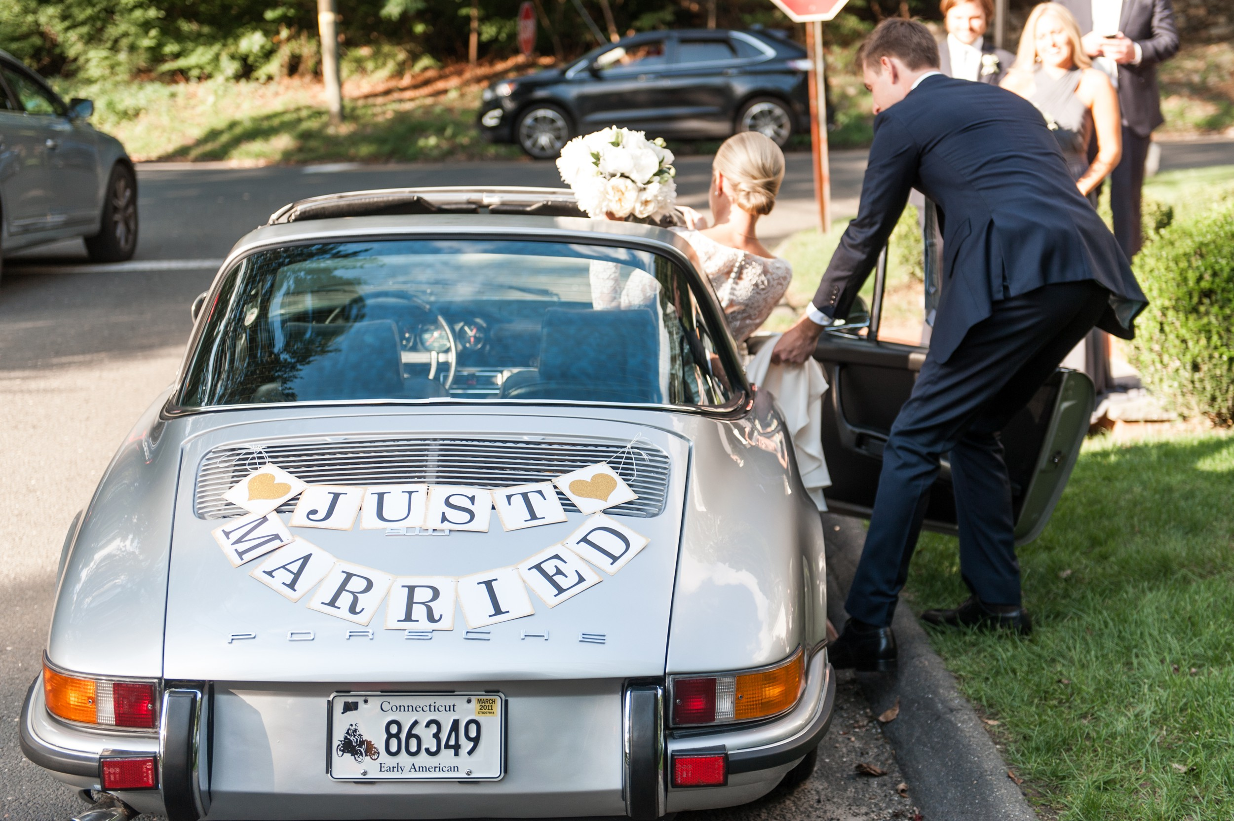 Wee Burn Beach Club Wedding Darien CT Talmidge Hill Community Church Wedding Ceremony bride and groom in getaway car with just married sign