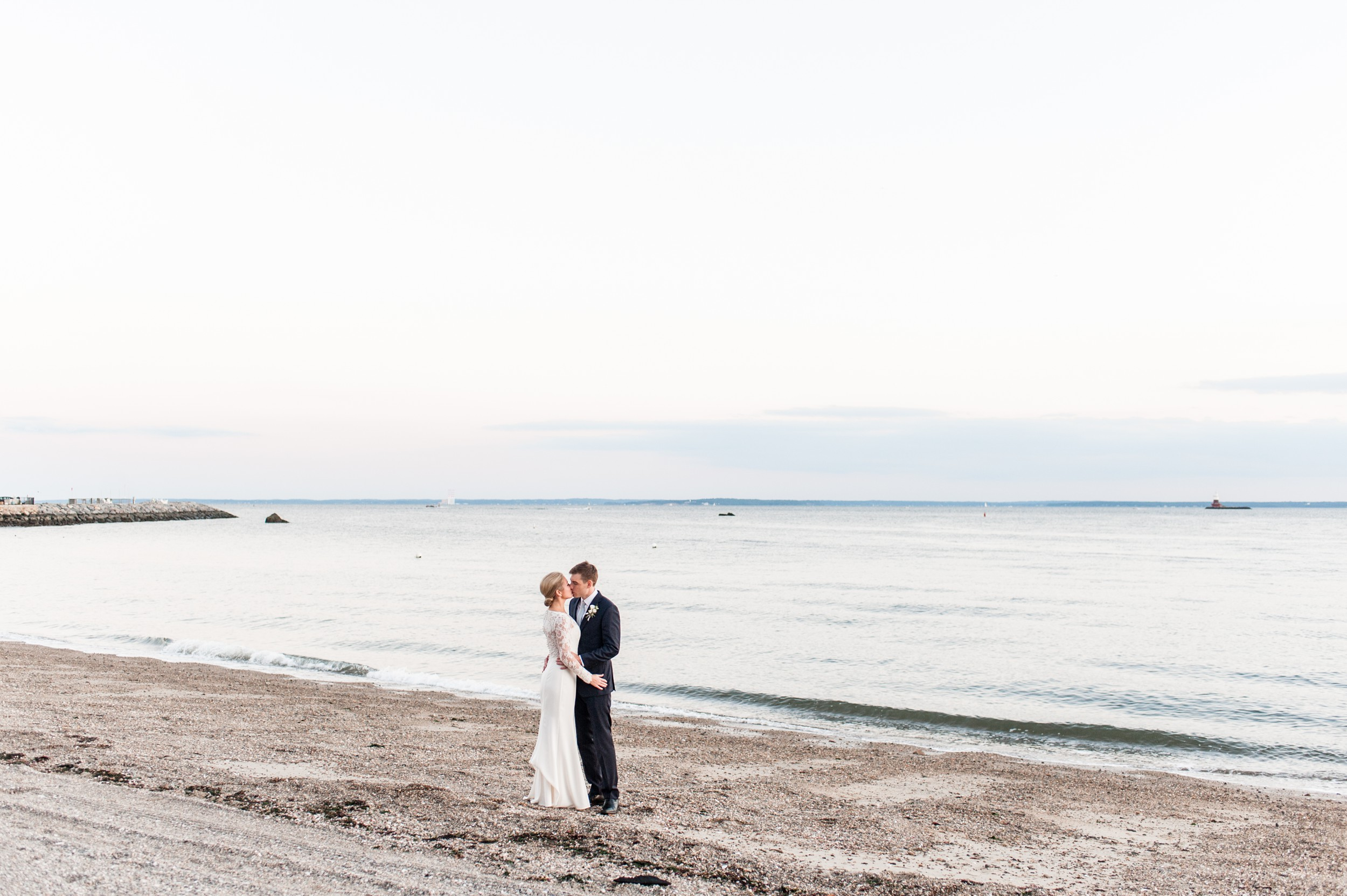 Wee Burn Beach Club Wedding Darien CT sunset portraits of bride and groom on the beach