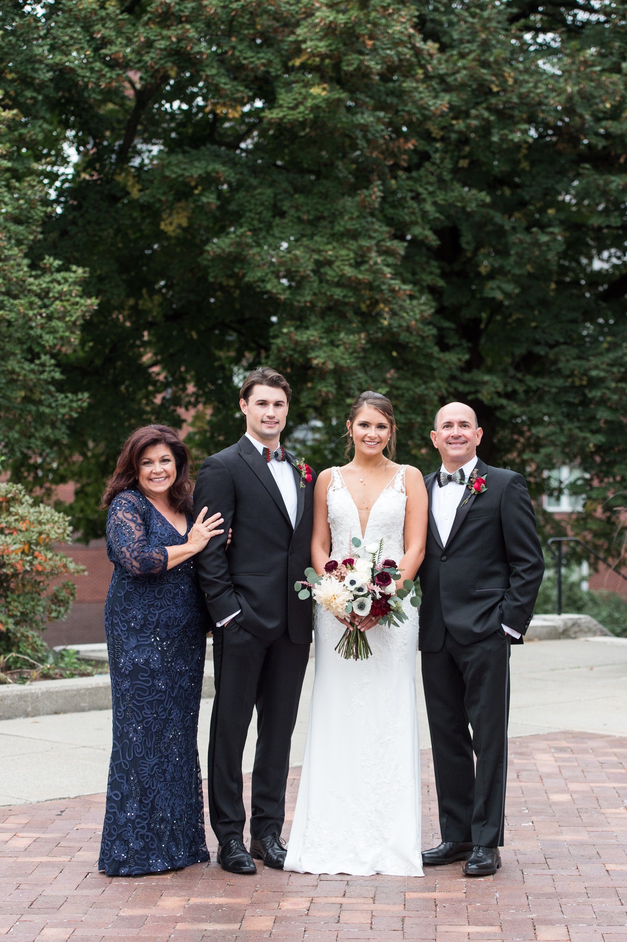 wedding planning family portraits made easy Holy Cross Wedding portrait of bride and groom with parents.jpg