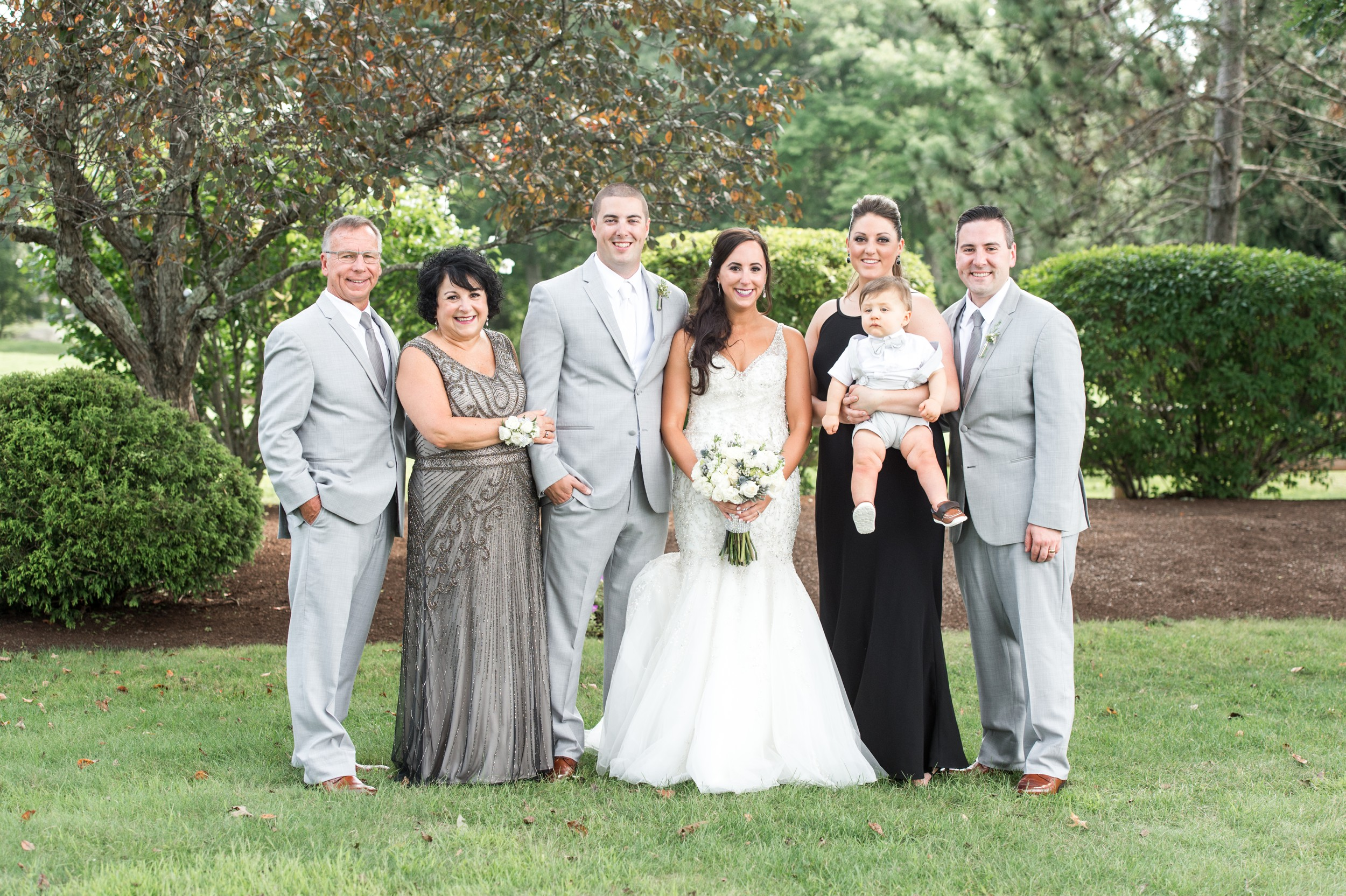 Family Portraits Made Easy The Villa at Ridder Country Club Family Photo with Nephew.jpg