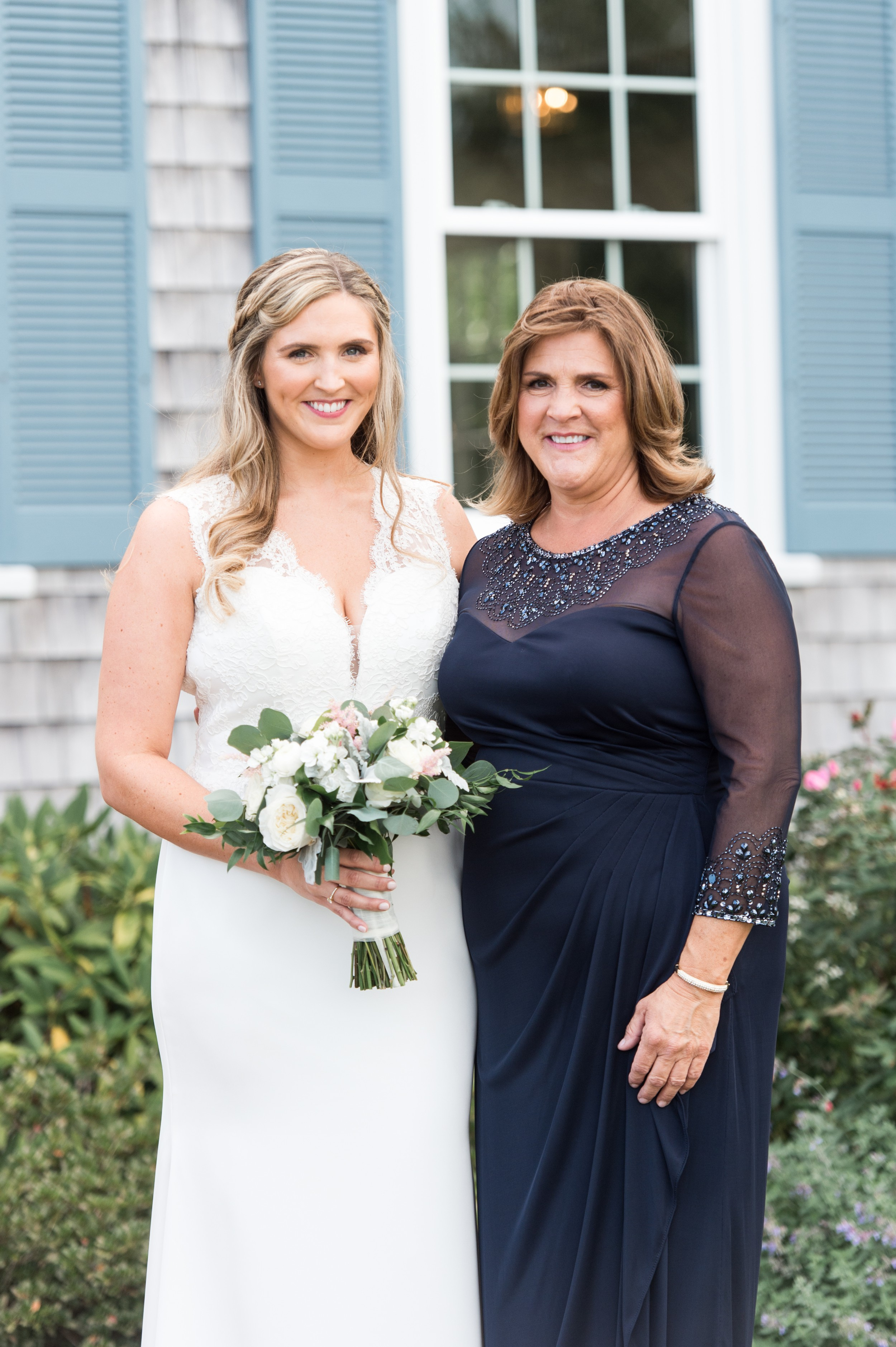 wedding planning family portraits made easy The Dennis Inn Wedding bride with her mom.jpg