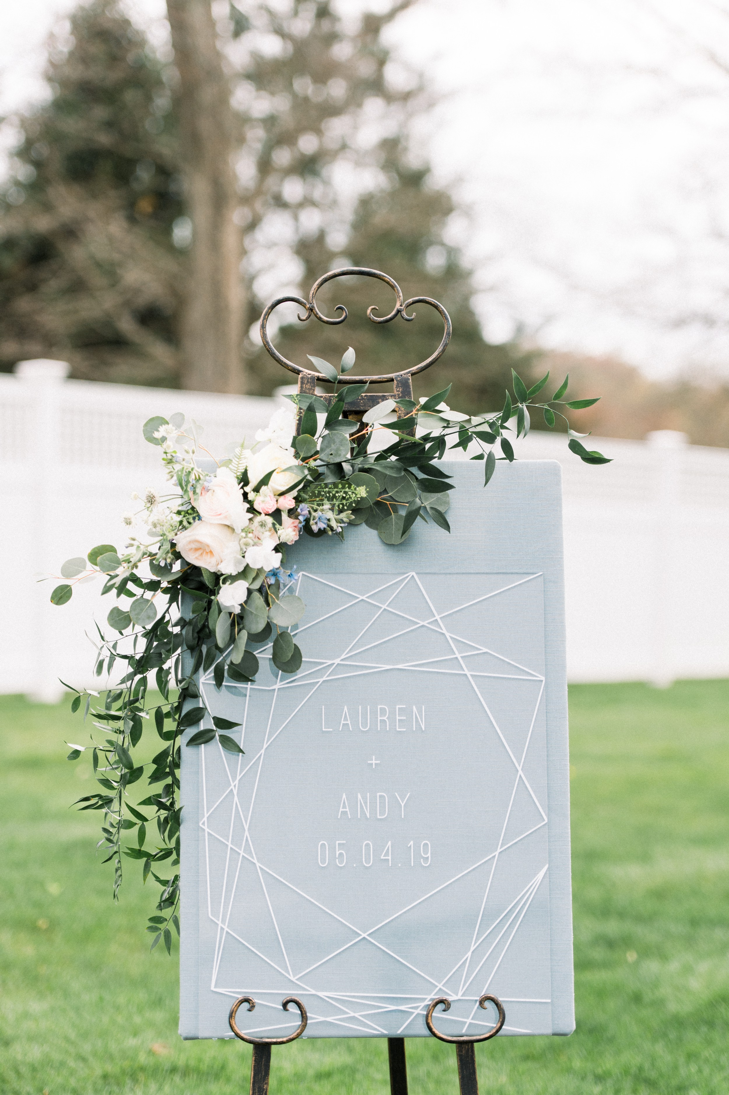 modern acrylic wedding welcome sign with florals and geometric shapes
