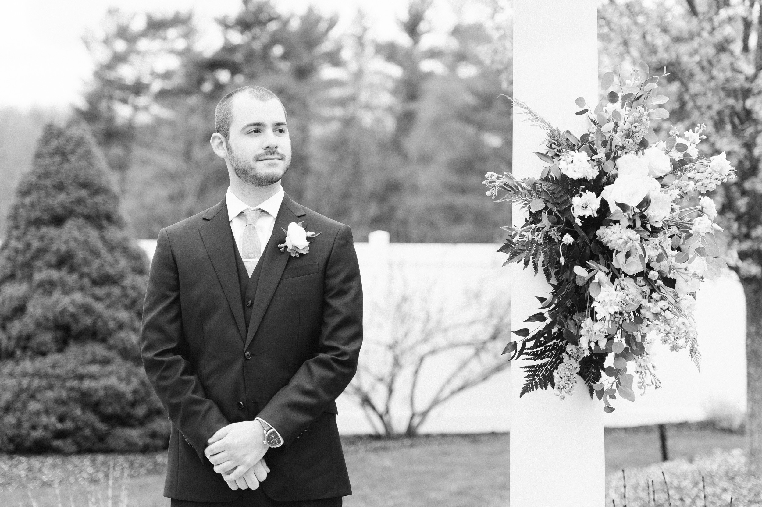 The Villa at Ridder Country Club Outdoor Wedding Ceremony in Spring groom seeing his bride in black and white