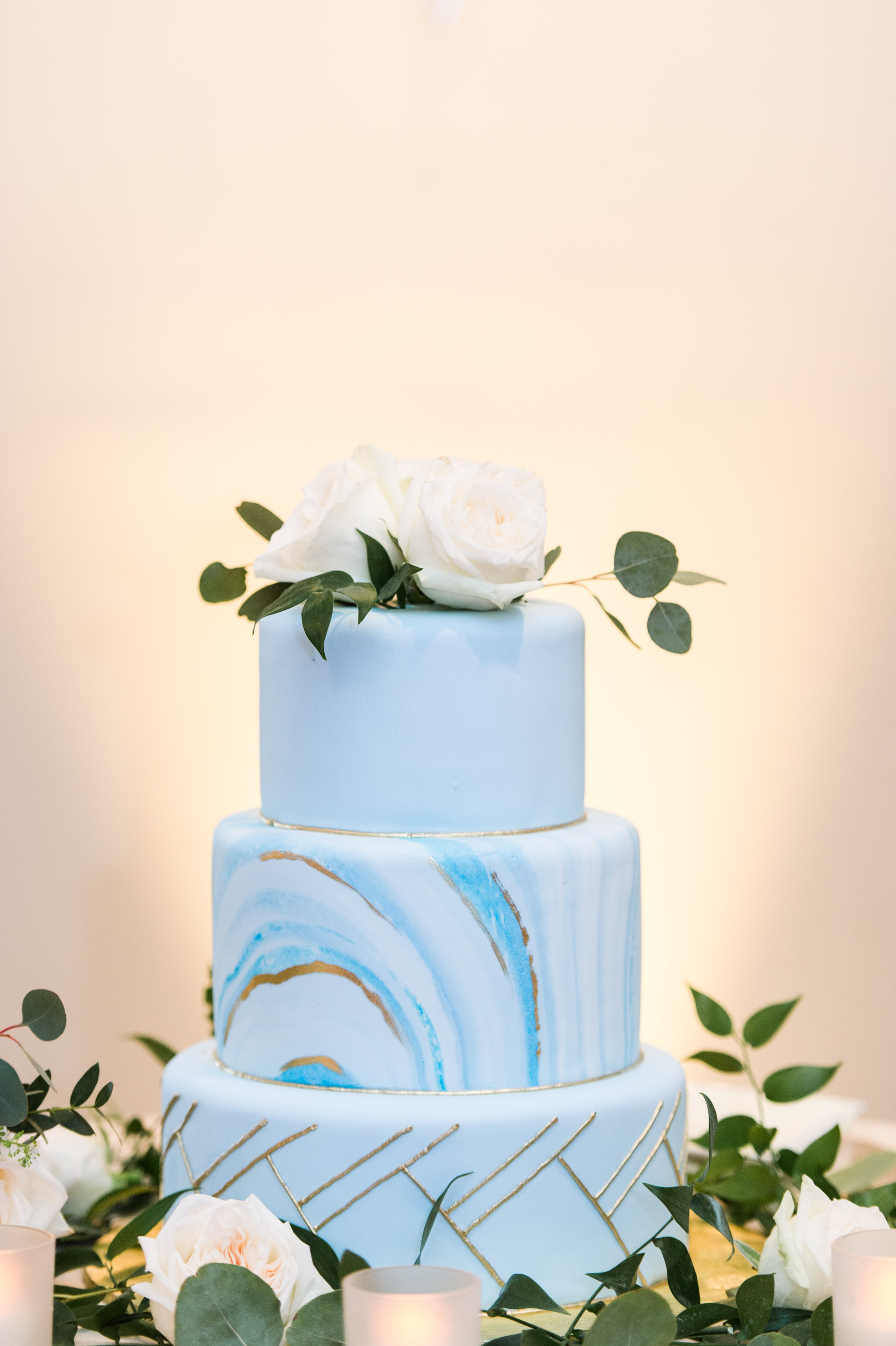 modern wedding cake in blue with geode design at The Villa at Ridder Country Club