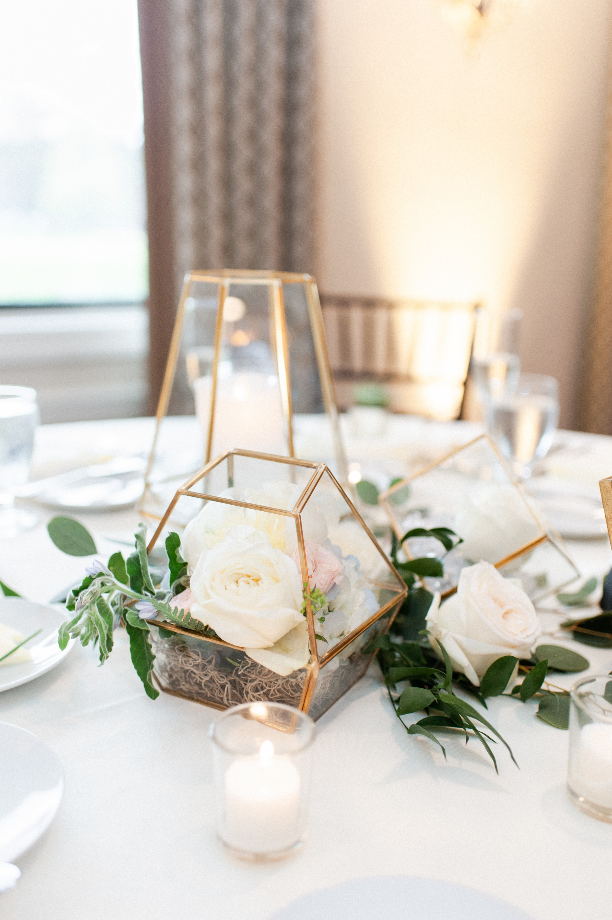 modern wedding reception centerpieces glass and gold terrariums in geometric shapes filled with flowers at The Villa at Ridder Country Club