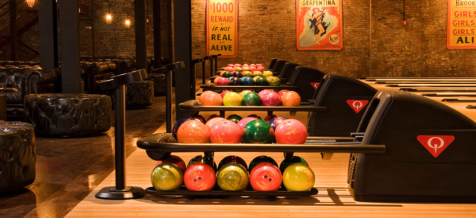 Bowling Alley With Colorful Balls in Racks