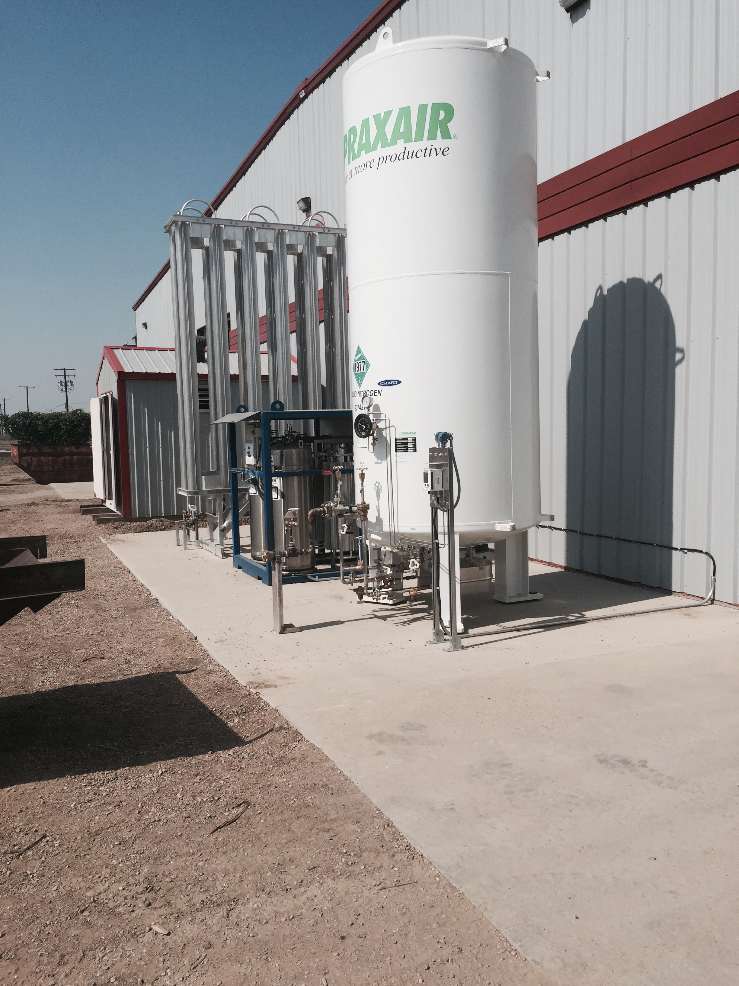 Here is the Bulk Nitrogen storage situated on the concrete pad that we highlighted in a previous post.  The Nitrogen is stored as a liquid and runs through the large aluminum structure to the left of the tank to change it from liquid to gas.