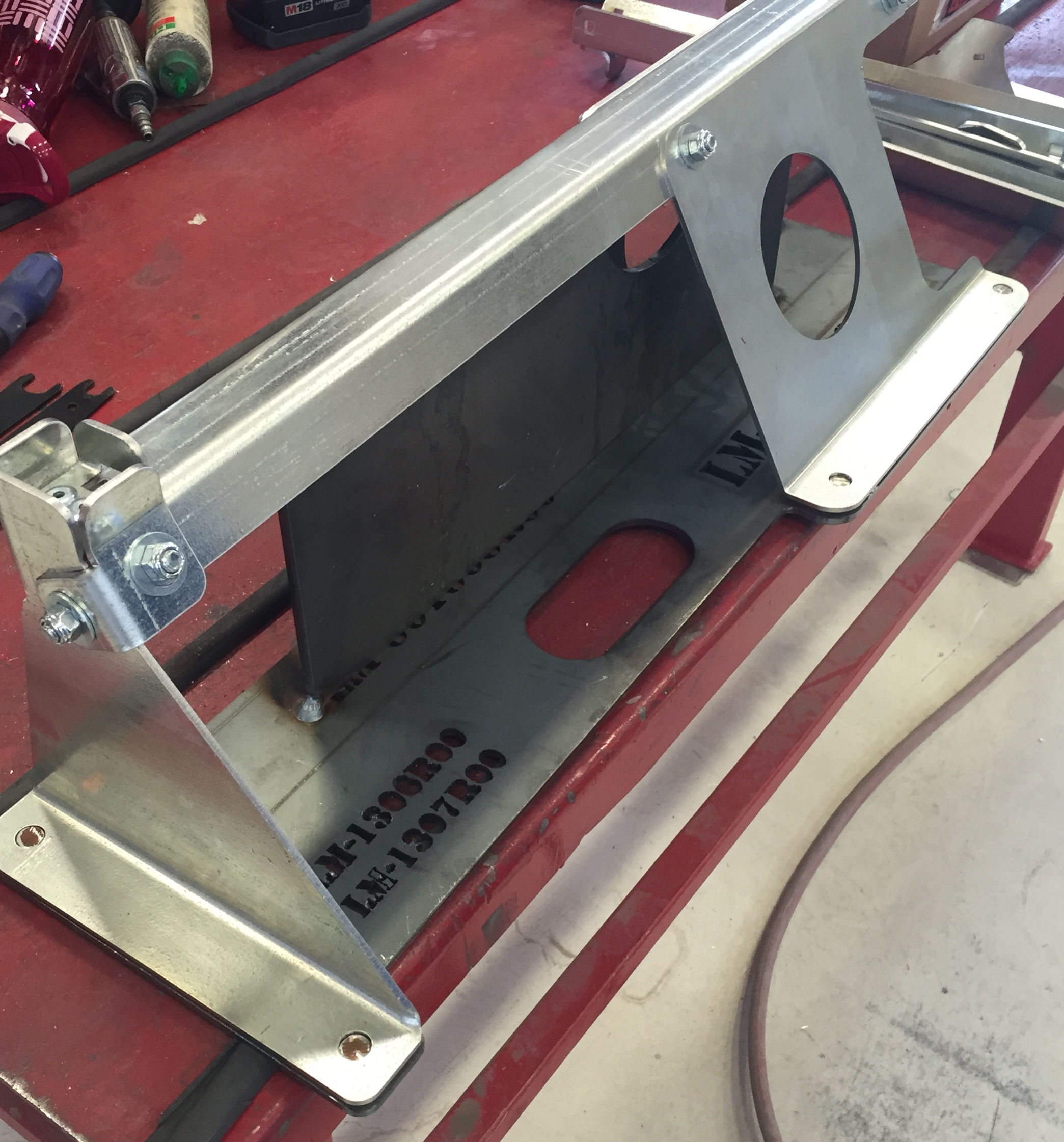 The galvanized steel sub-components are placed on the jig and bolted together.