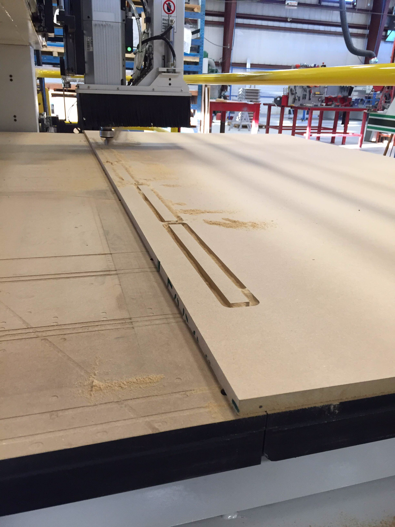 """3/4"""" MDF being cut on one of our CNC routers for a local kitchen cabinet making shop."""