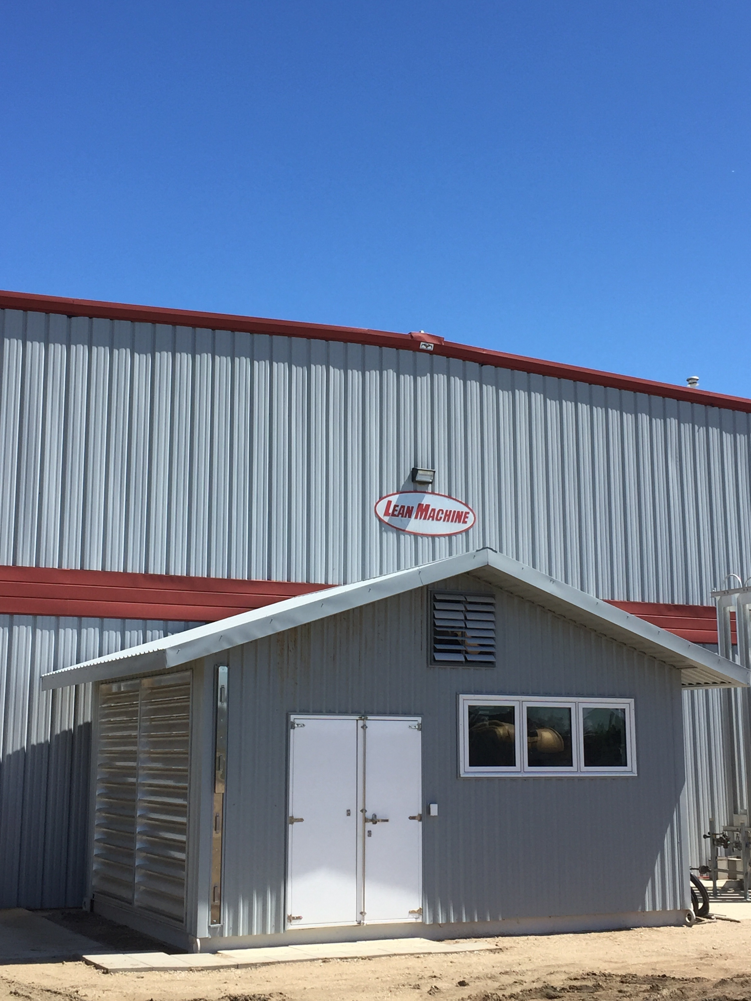 """If you are driving by our plant you may notice the new compressor structure off the back of the building. The base is made of steel so the entire structure can be moved easily for future expansion. The bottom side of the steel base has 8"""" of spray foam insulation."""