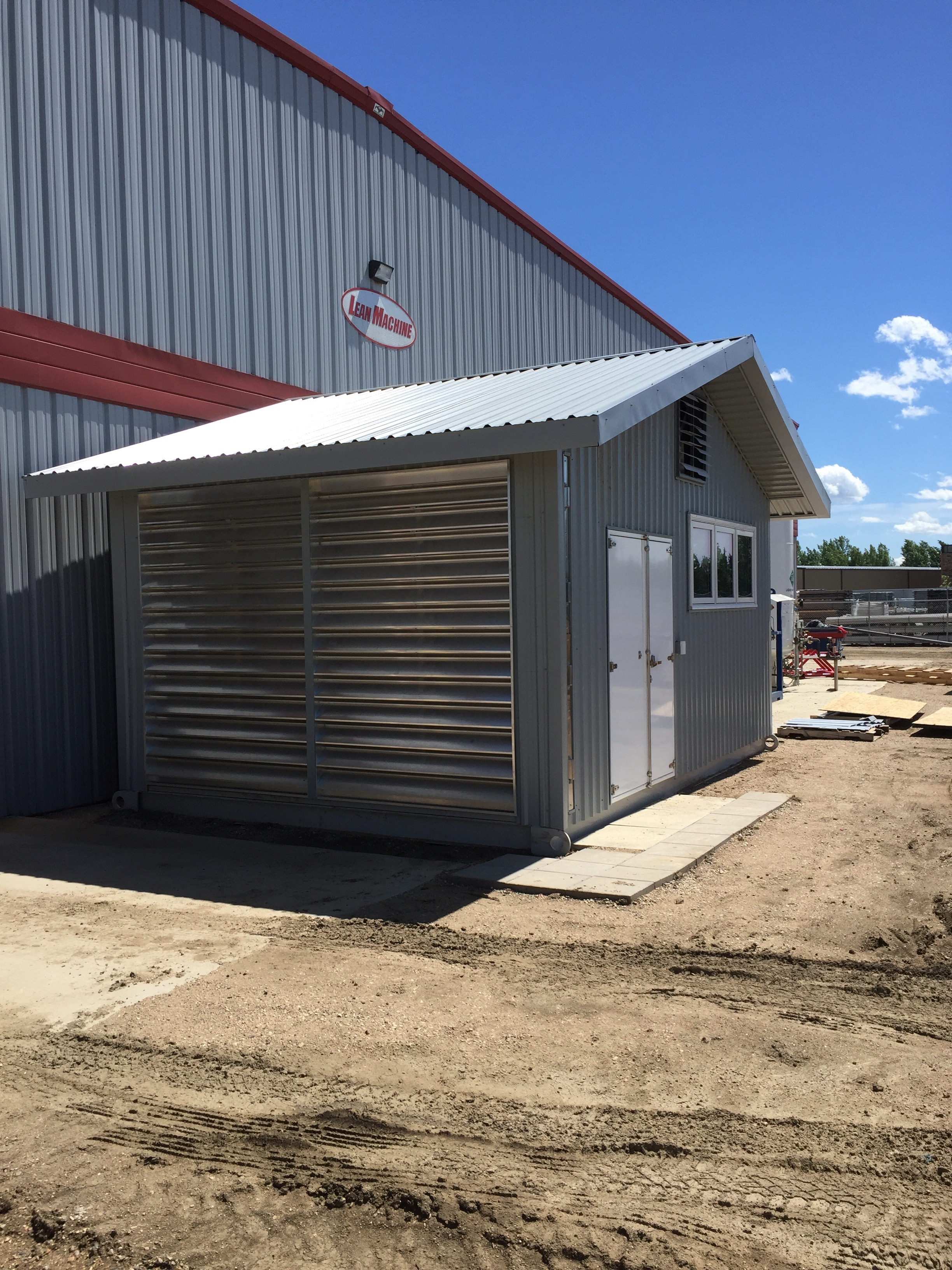 The north side of the structure is the intake and has louvers to keep driving rain or snow out.  The north side intake means prevailing winds help to increase airflow.