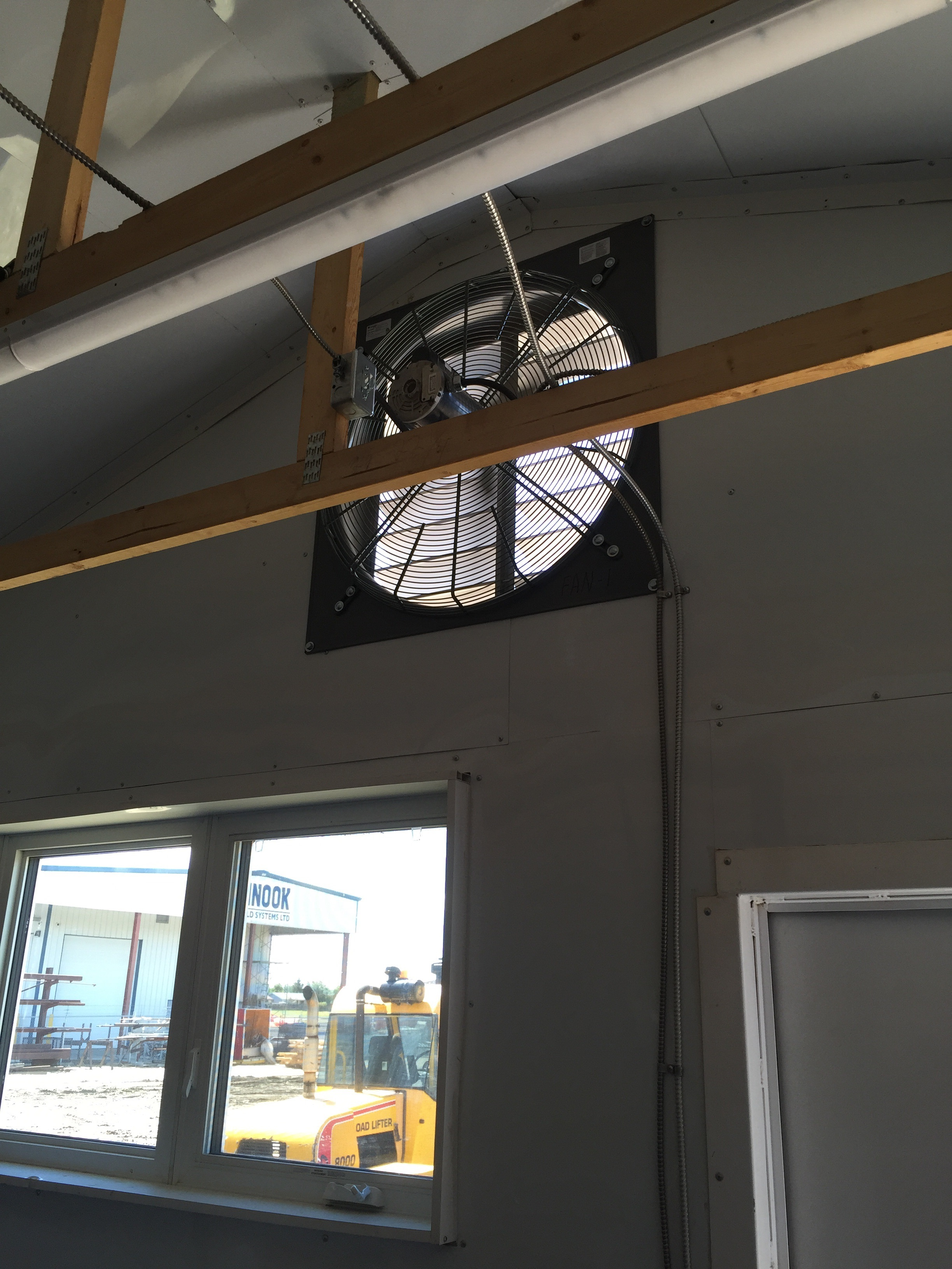 A gable mounted cross draft fan was installed to add additional cooling as well as draw in warm shop air in the cold winter months to prevent freeze up.