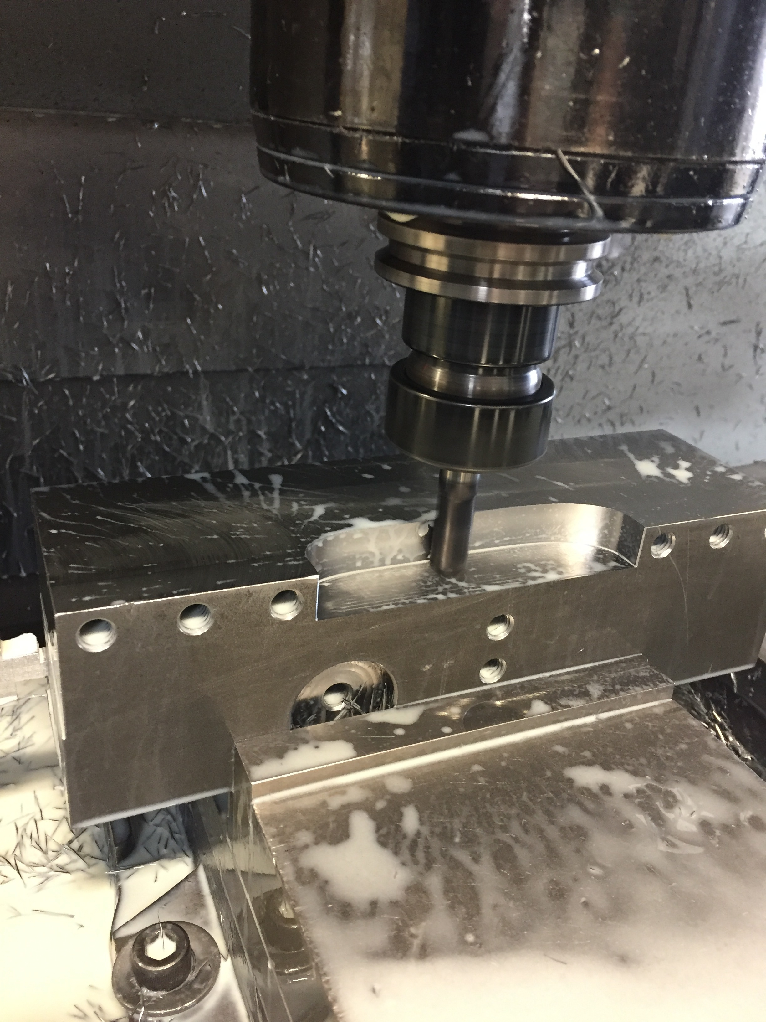 """Our Haas VF4 milling the tool block. This is a steel 3""""x3"""" billet.  Iscar's endmills are the greatest!"""