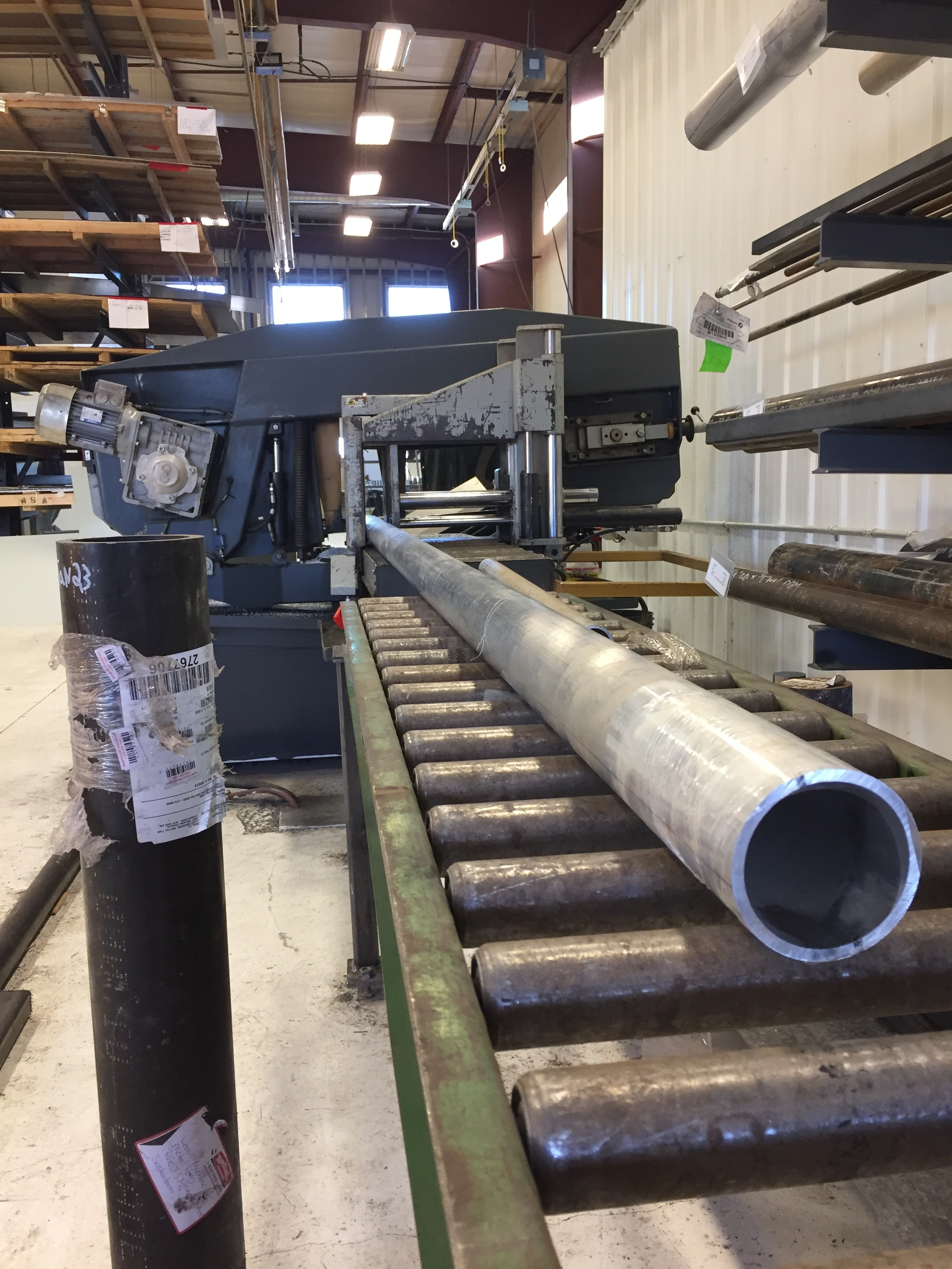 """The material is loaded into one of our saws. Here is the back-end of our Hydmech S23-A band saw.  The """"-A"""" in the saw model number denotes it's fully automatic feeding capability."""