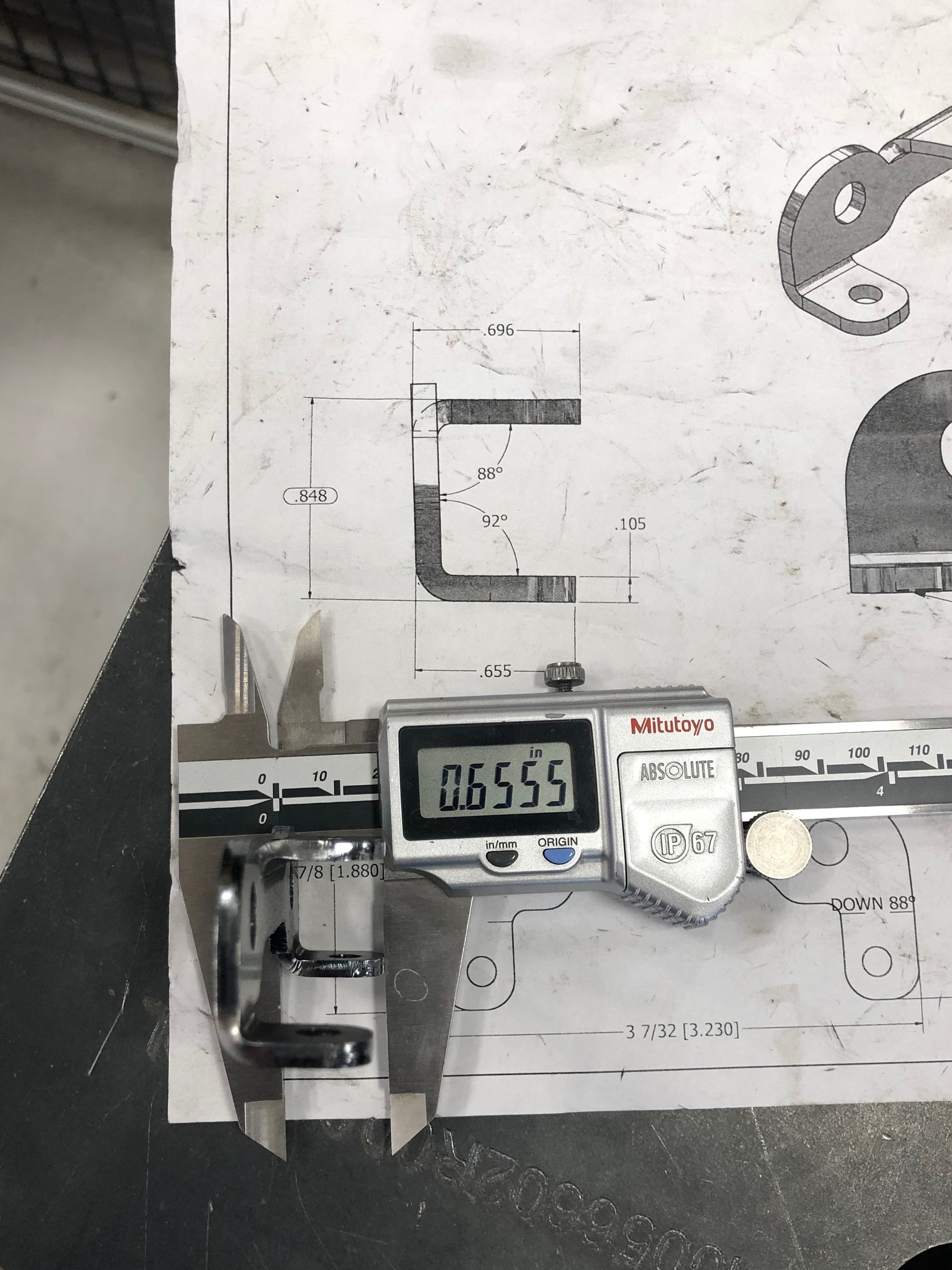 "the drawing says 0.655"" and it measures 0.6555""!! This may be a really good part for the picture but we haven't seen a variance of more than 0.005 and less that 0.25 degrees between parts. On a side note, this is why we don't use any paper drawings in the shop any more :)"