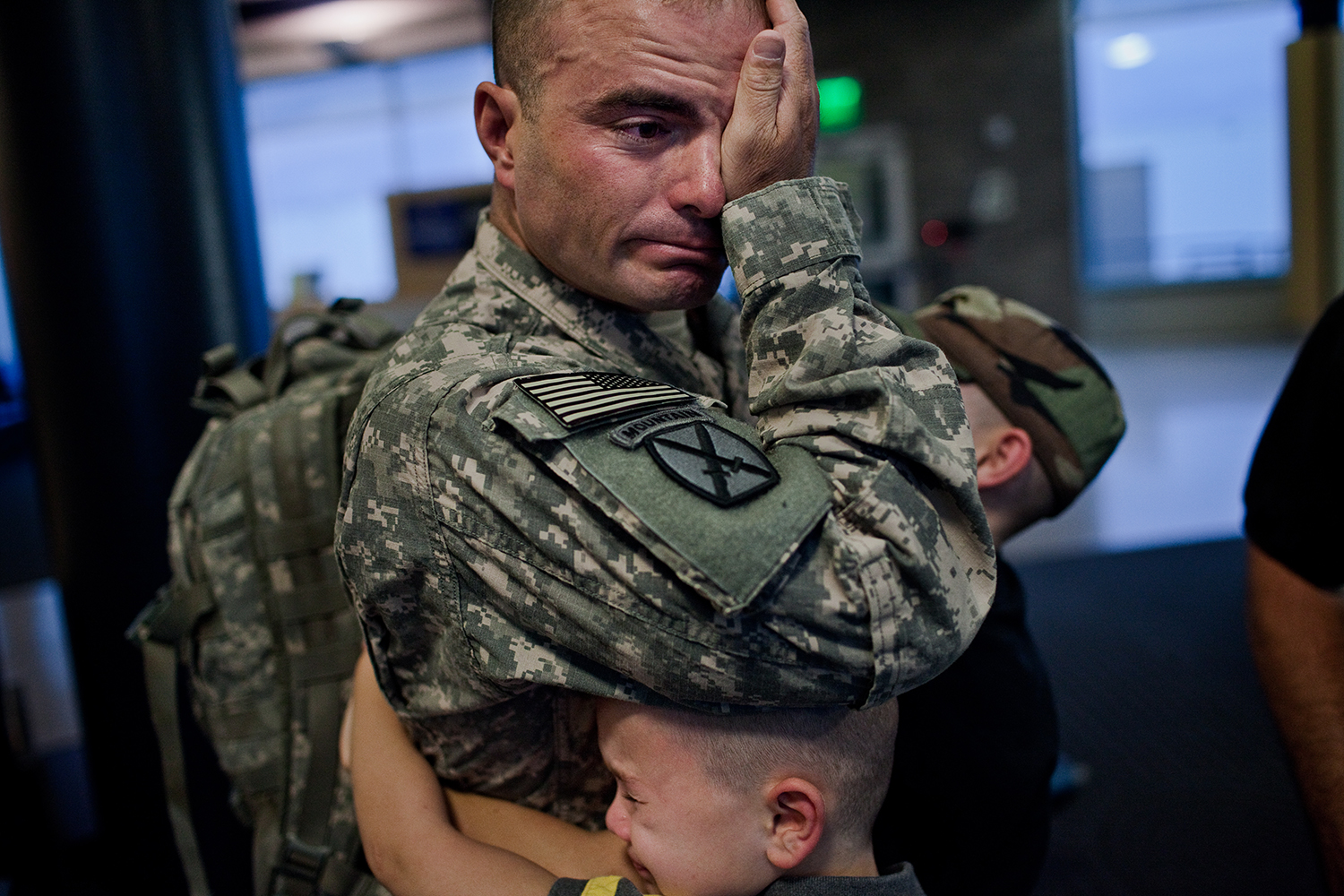 Sergeant First Class Brian Eisch weeps, as he struggles to say goodbye to his children.