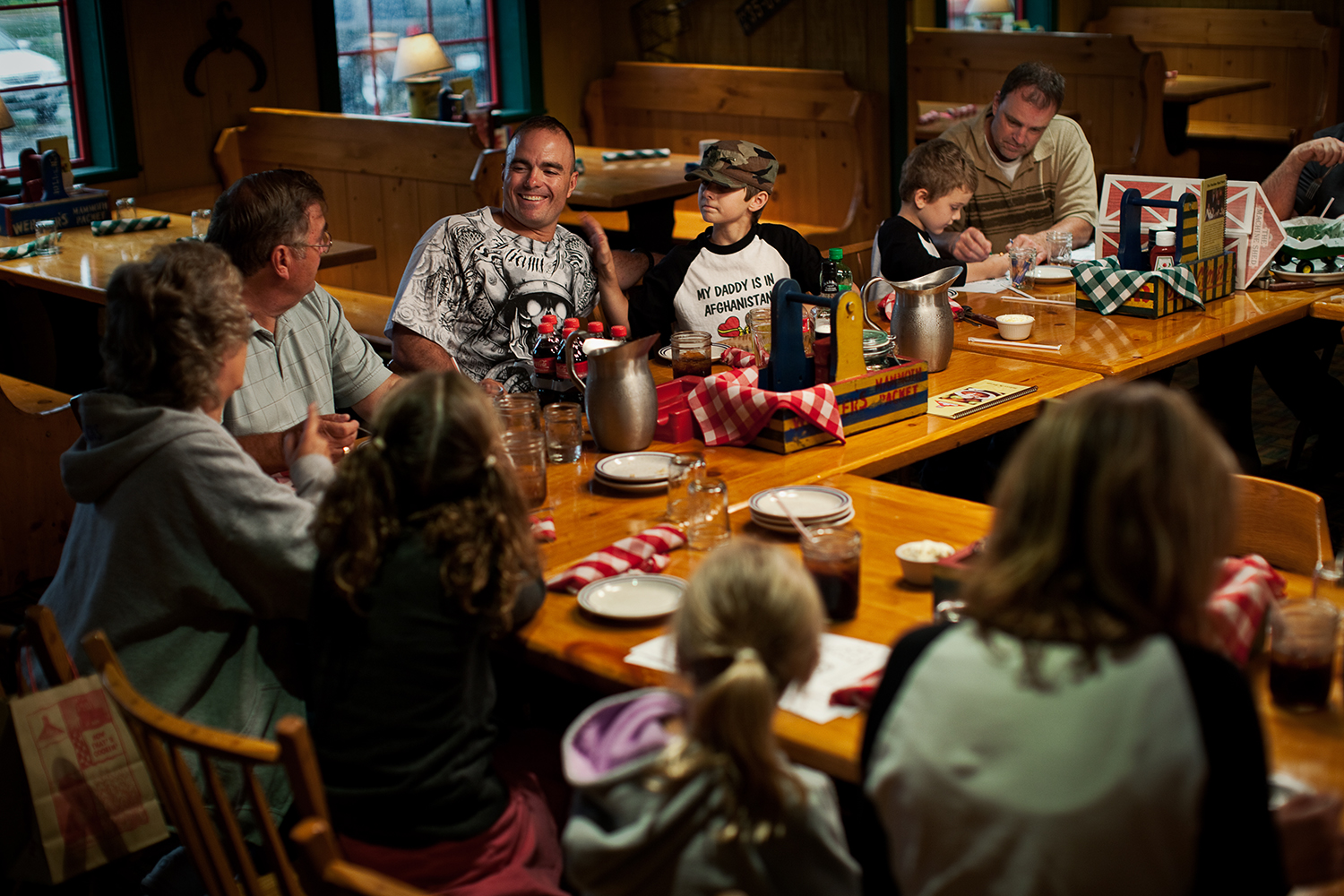Friends and family of the Eisch family dine together to celebrate Sergeant First Class Brian Eisch's mid-tour leave in Appleton, Wis.