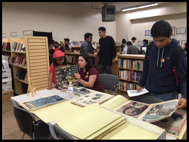 Students from a youth leadership program look at materials from the Library's archives.