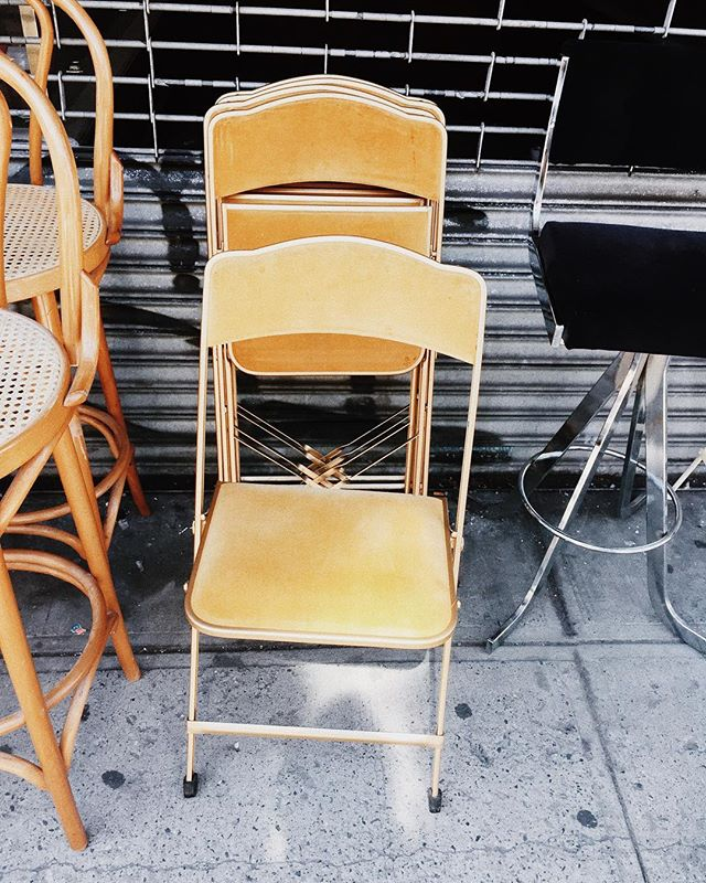 Serious question. Do @gypsy_nomad & I buy these foldable, yellow velvet dining chairs for our apartment or not? ✨