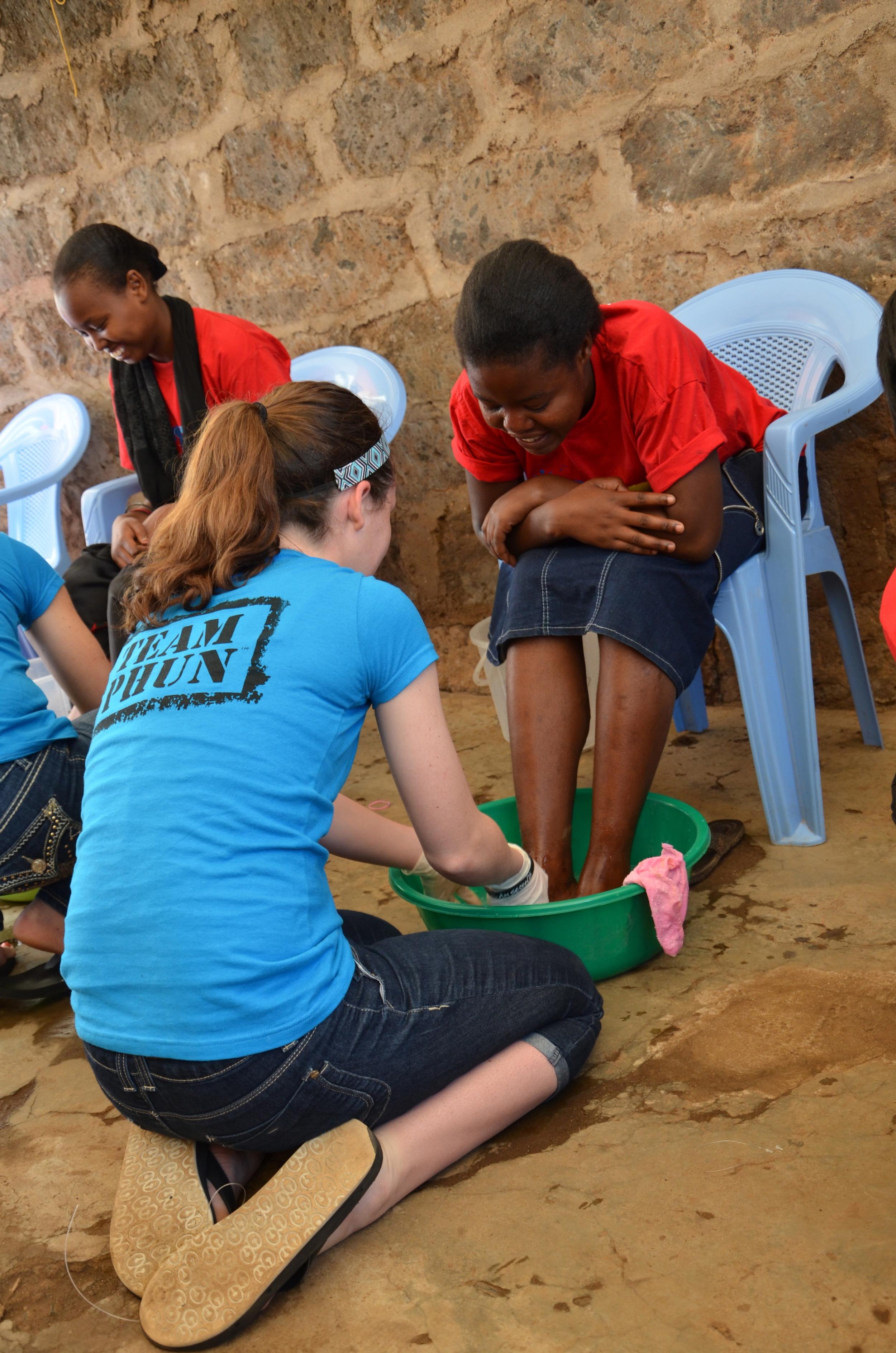 Georgia washing a girls feet to demonstrate John 13.