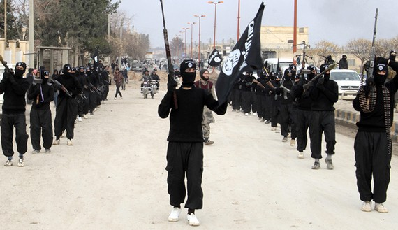 ISIS fighters on parade in Syria. (photo by REUTERS/Yaser Al-Khodor)