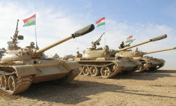 Kurdish Peshmerga troops and tanks. Photo: Reuters