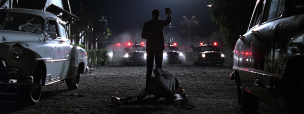 """""""Hold up your badge, so they'll know you're a policeman."""" From the corrupt cop film   L.A. Confidential ."""