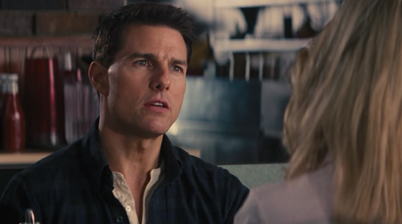 """Tom Cruise as Jack Reacher, listing the """"four types"""" to Rosamund Pike's Helen Rodin."""