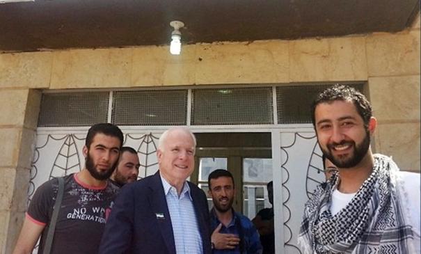 US Senator John McCain with mujahideen from the Northern Storm Brigade.